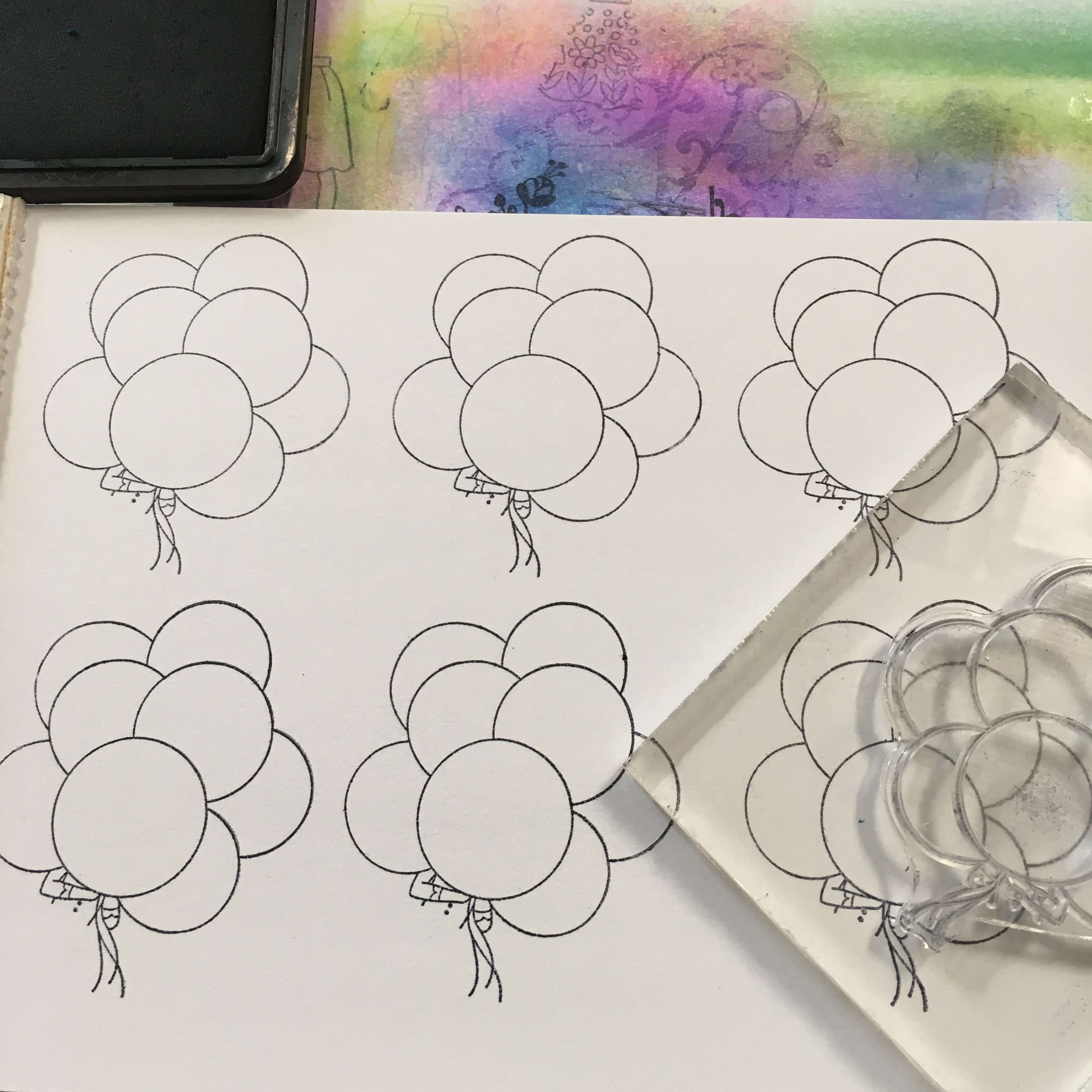 acrylic block and clear stamp, stamping balloons on a white sheet with a black ink