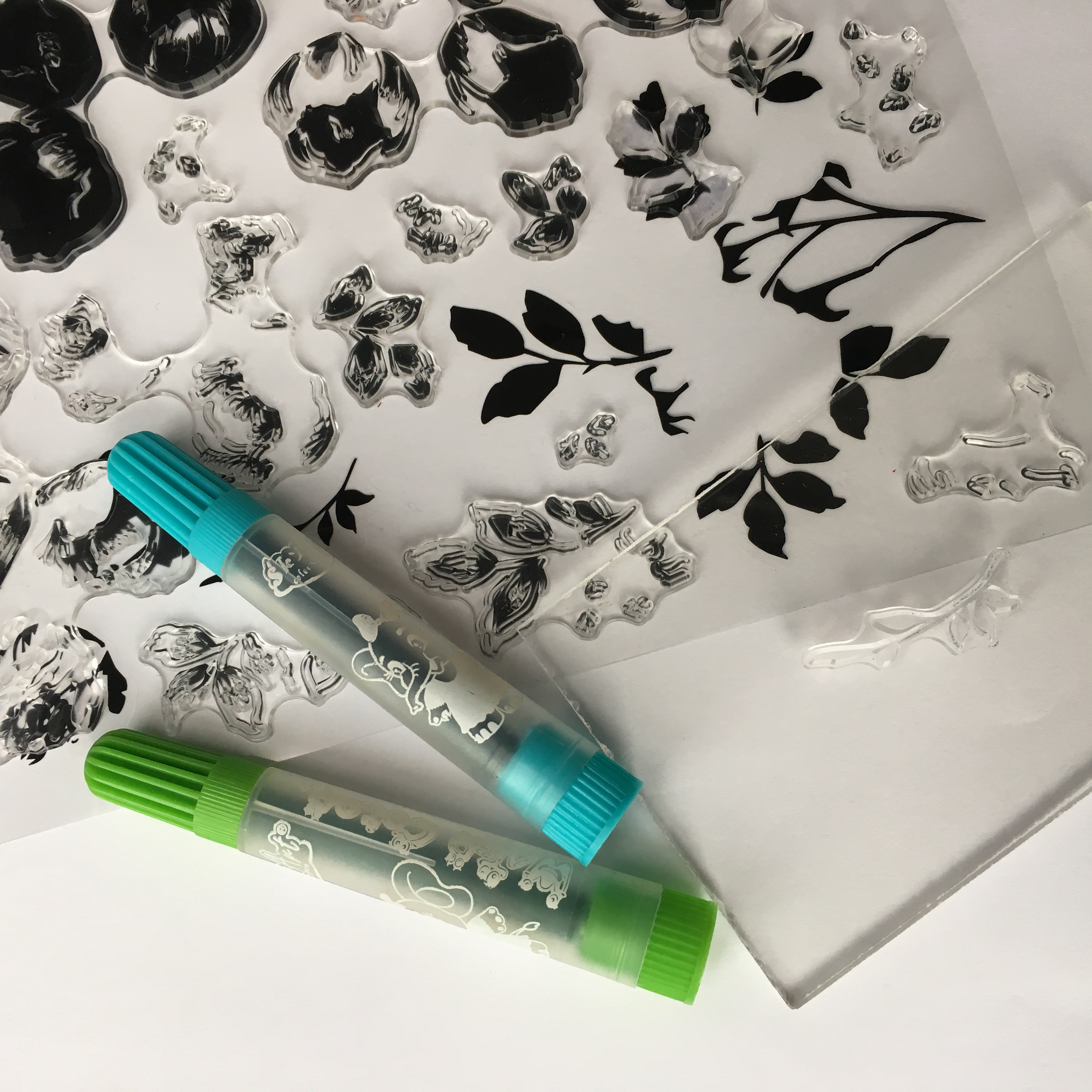 clear stamps, watercolour markers, acrylic stamping block and white paper