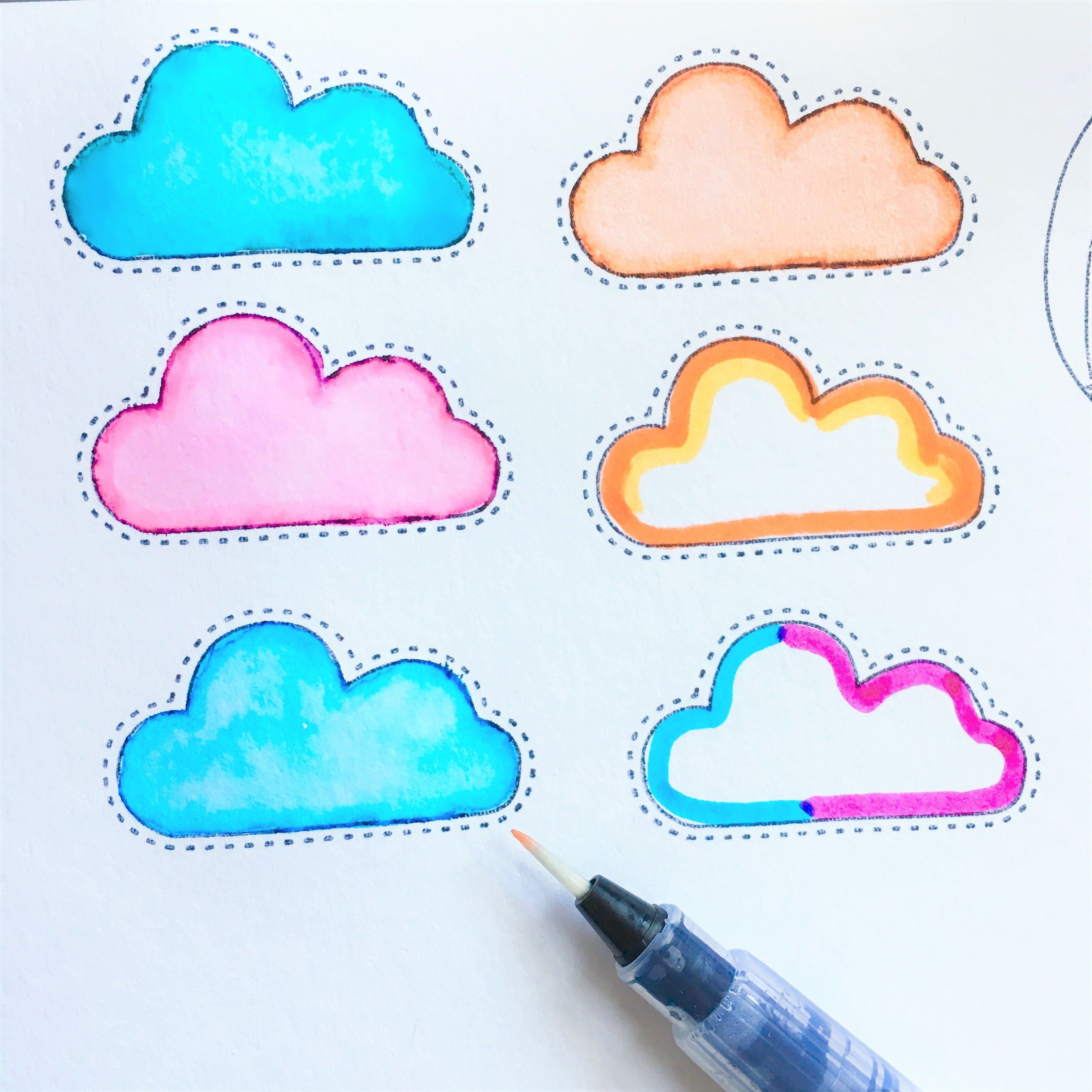 stamped clouds, coloured with markers and watercolour brush