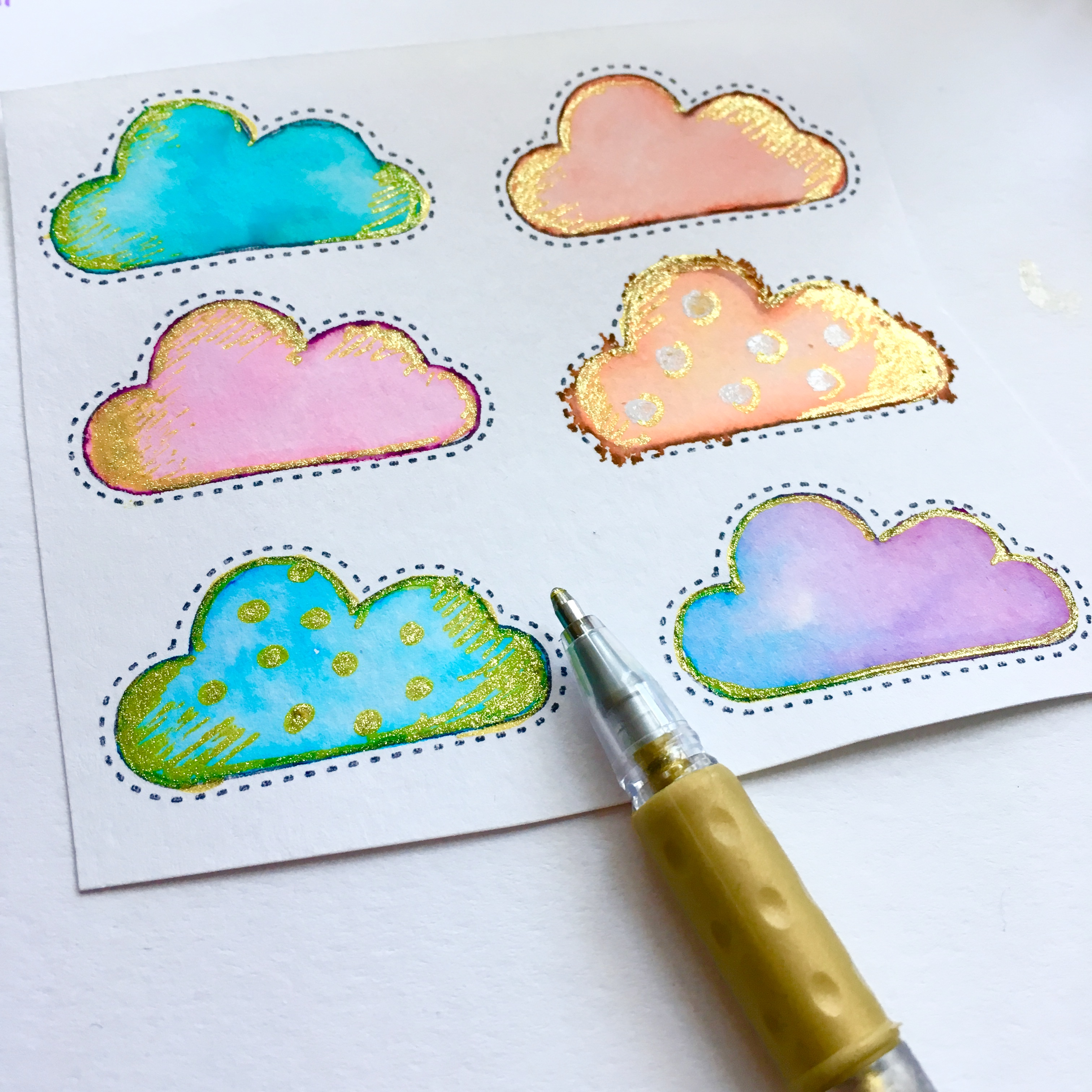 clouds, coloured in blue, orange, pink and purple with some glitter