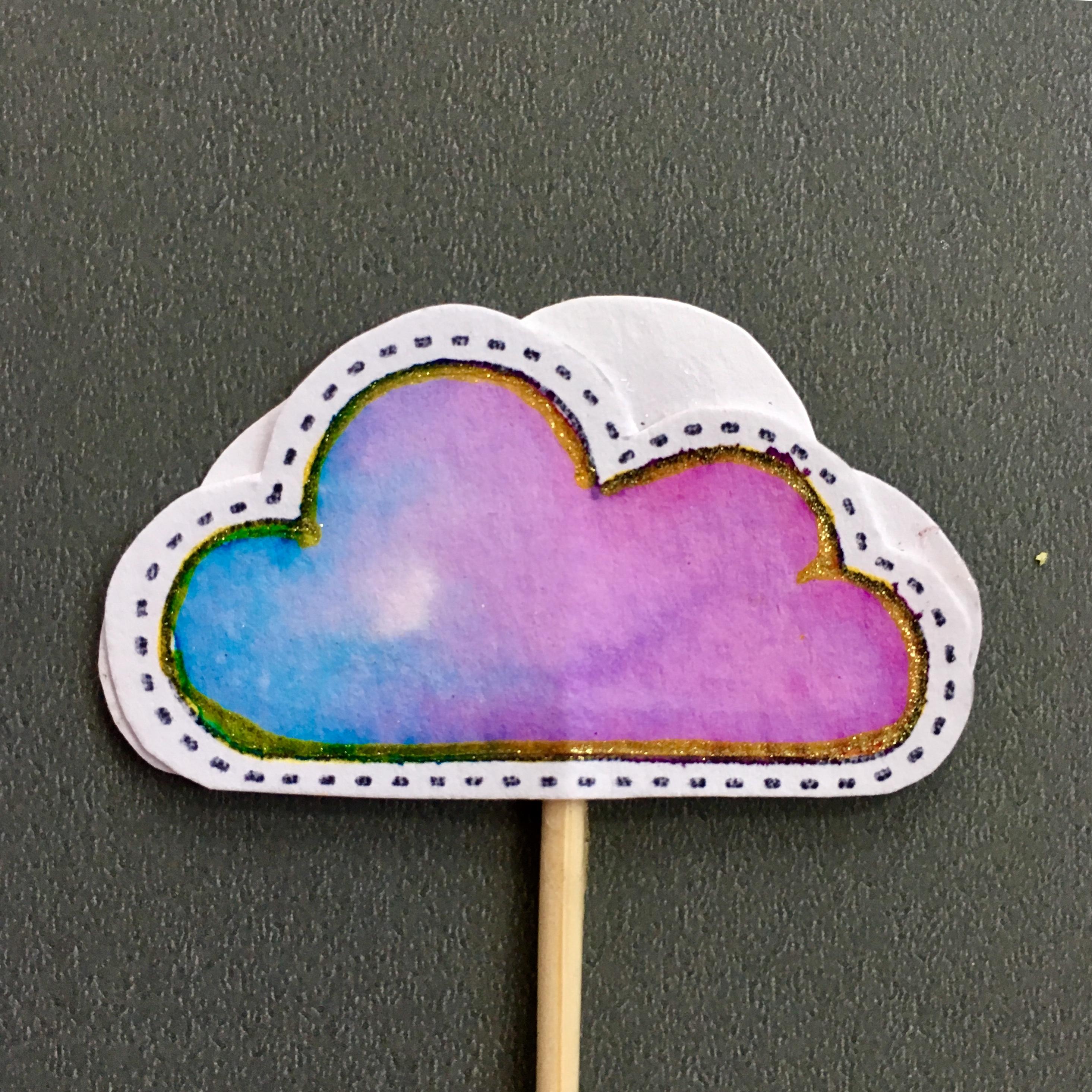 paper cloud muffin topper in purple and blue