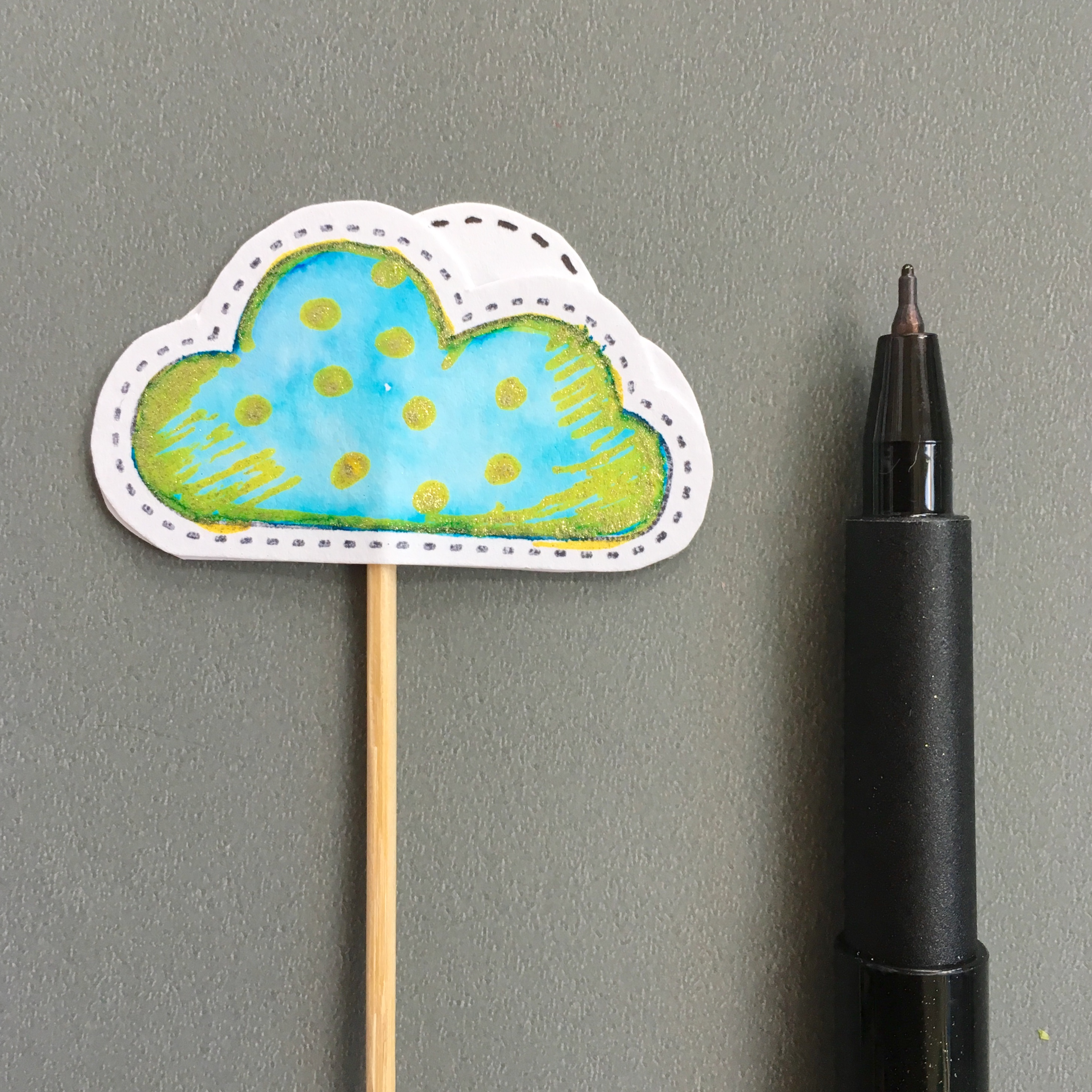 cloud shape paper muffin topper in blue and gold