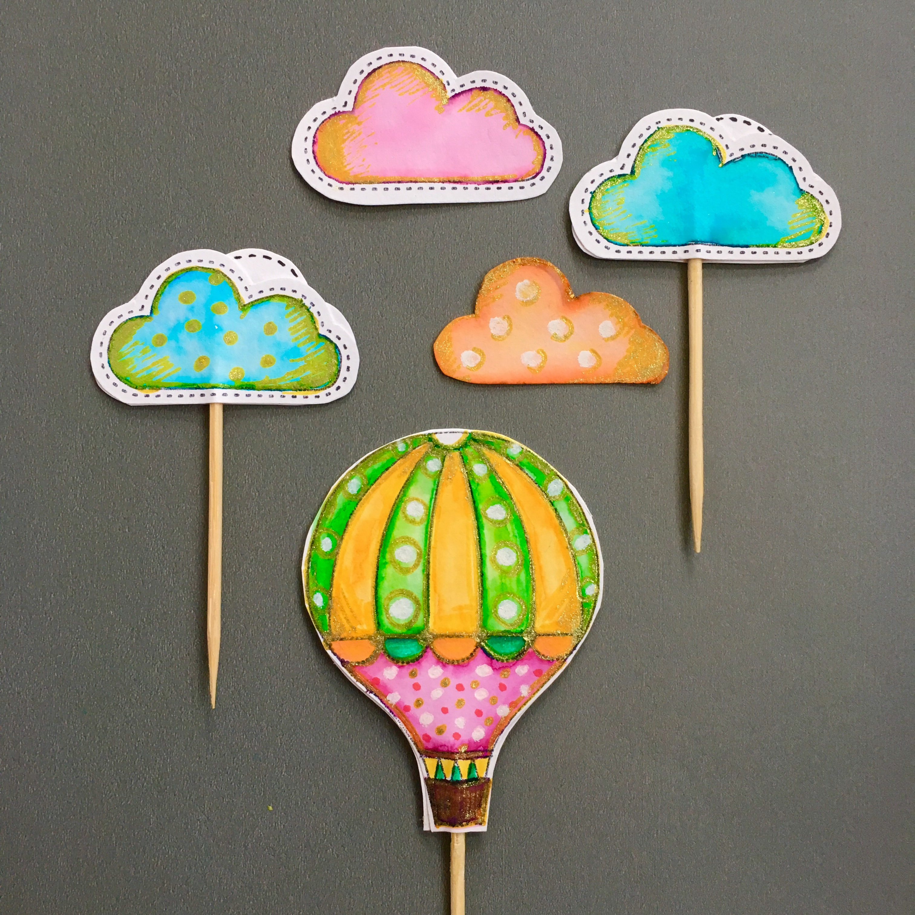 hand drawn muffin toppers - hot air balloon (green, yellow, purple, white, glitter) and clouds (blue, pink, orange, white, glitter)