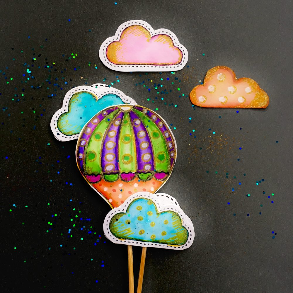 handmade paper muffing toppers -hand drawn hot air balloons and clouds in blue, green, purple, pink and orange with glitter sprinkles