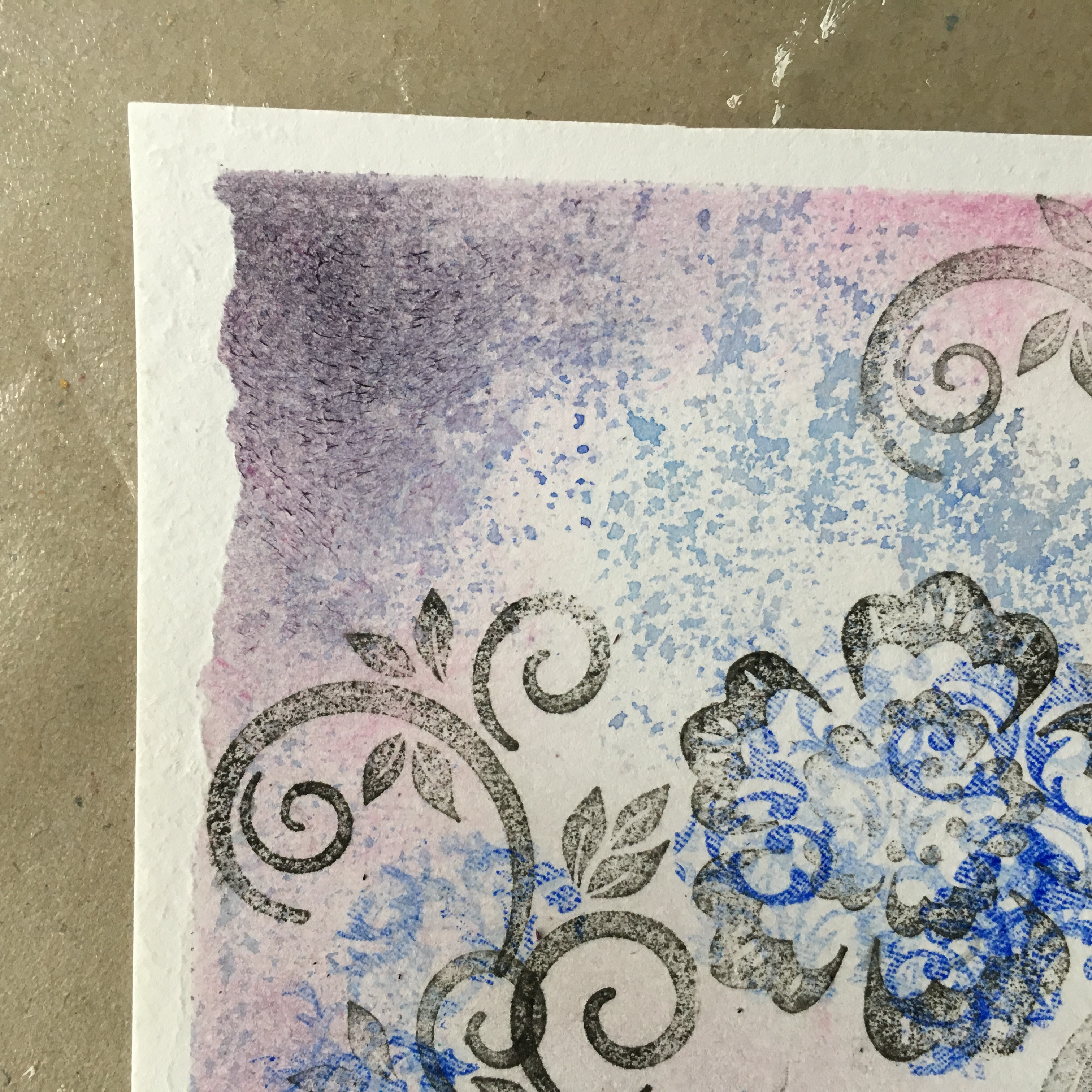 greeting card background floral design in blye, black and purple made with blending and stamping