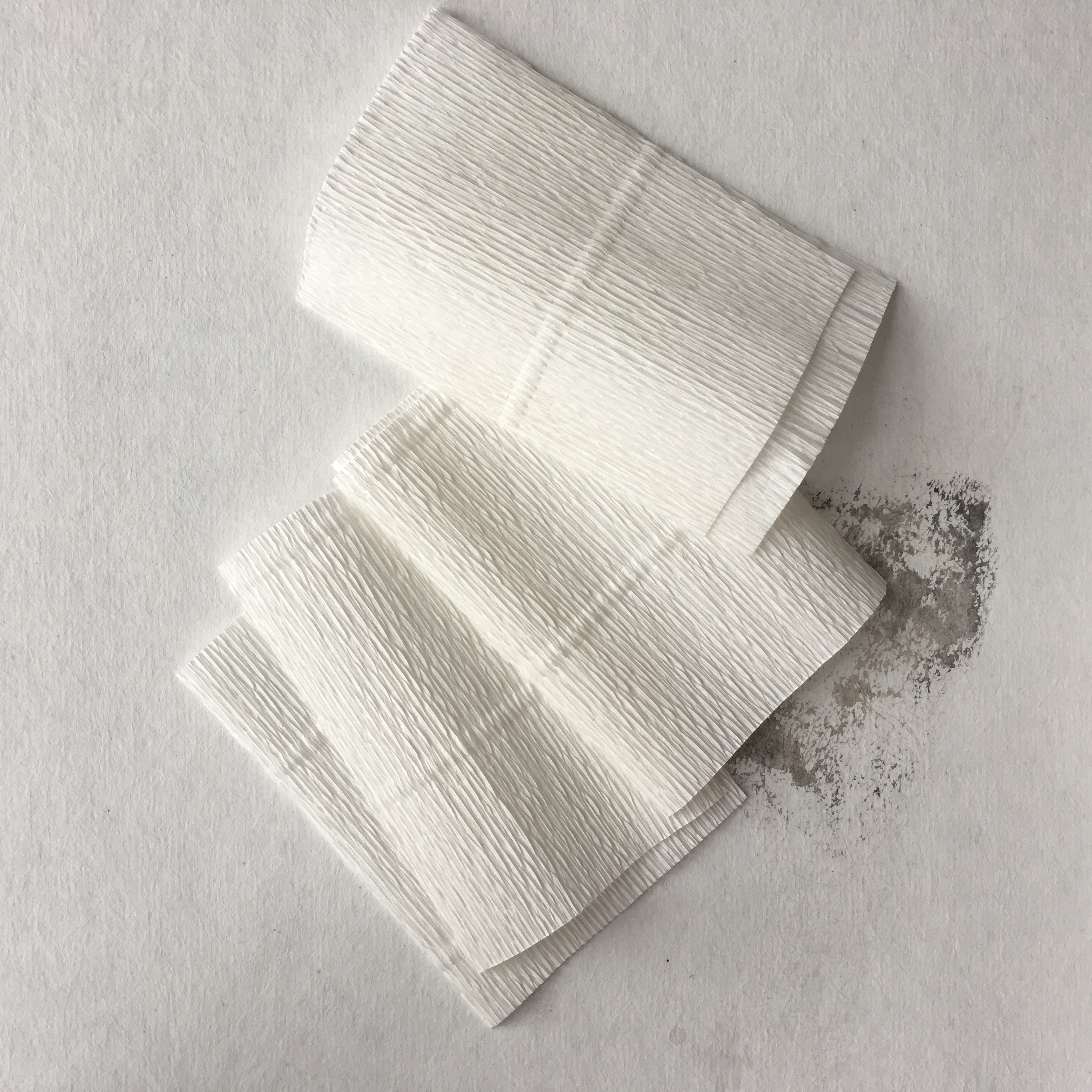 white rectangle pieces of crepe paper