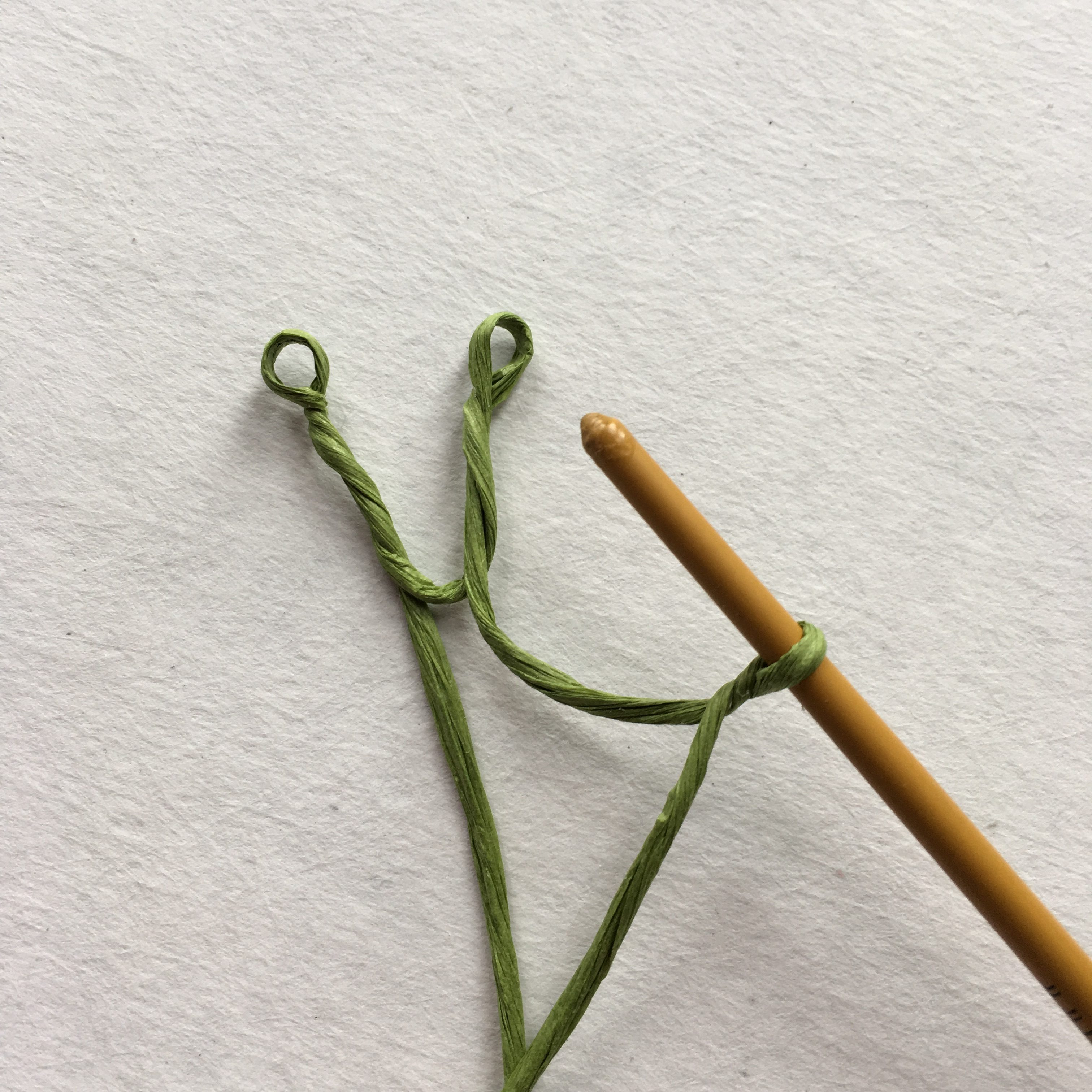 twisting paper wire with wooden stick