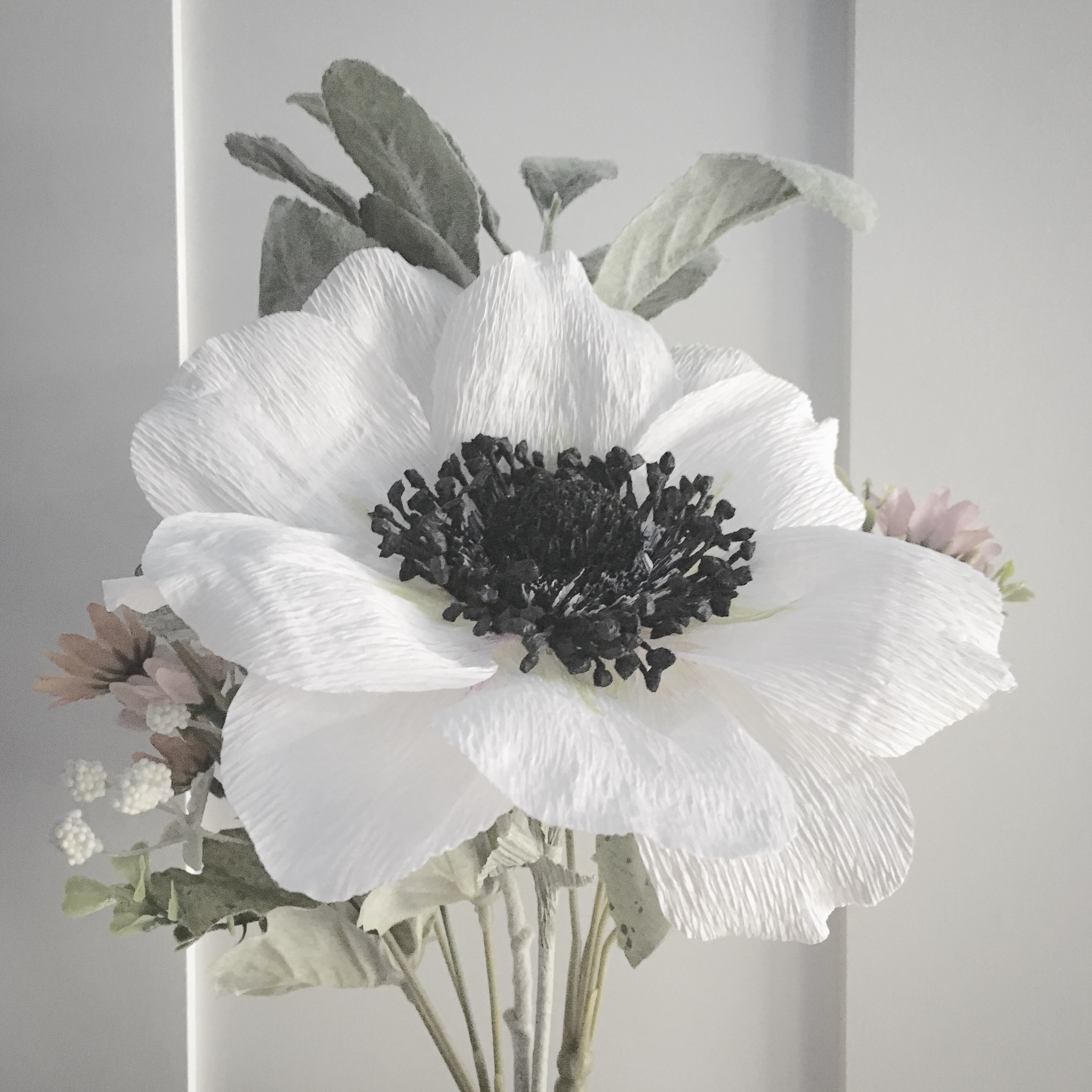 crepe paper anemone in white and black on a white background