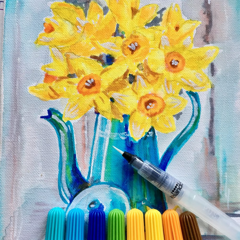 yellow daffodils in blue vase and watercolour markers