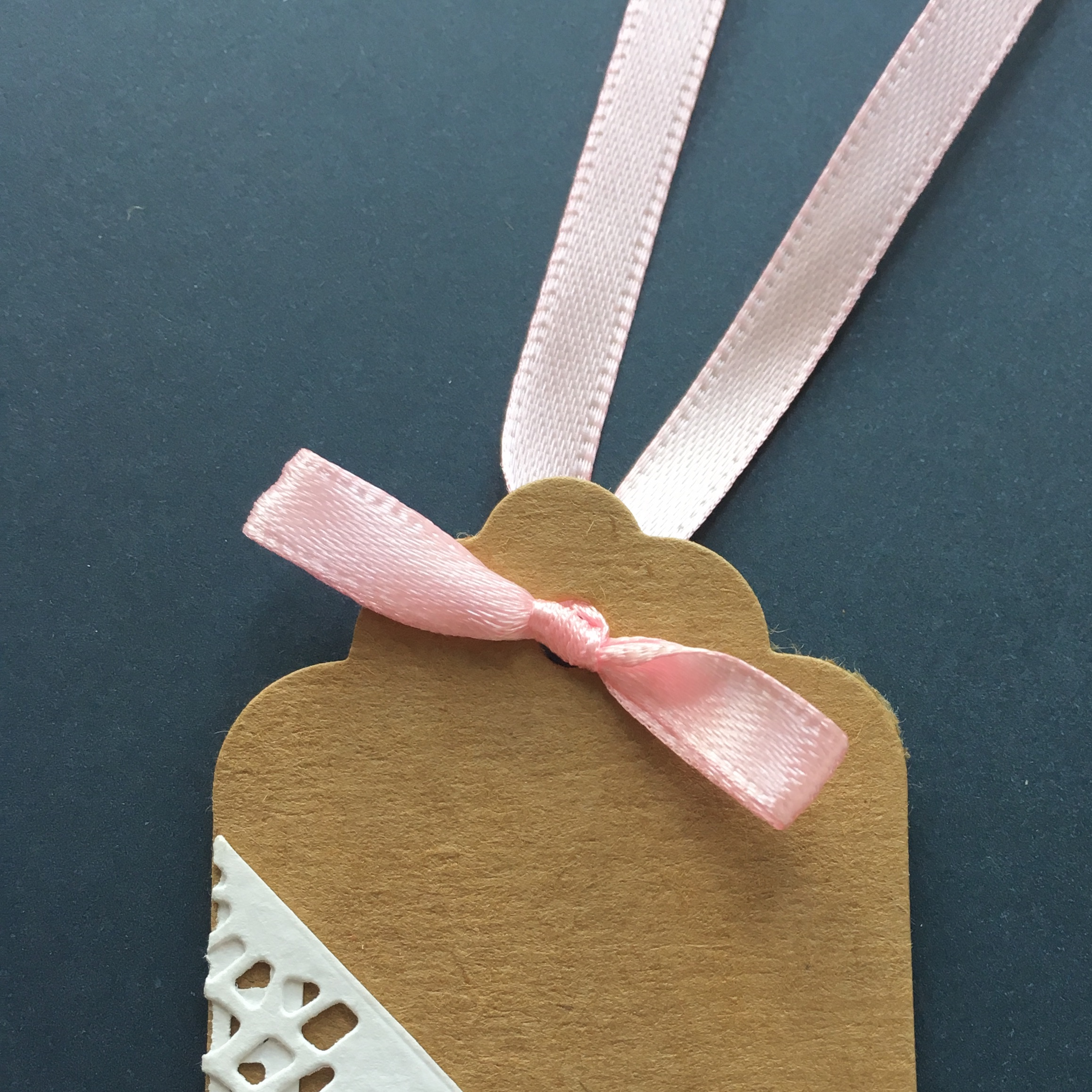 pink ribbon bow on a gift tag