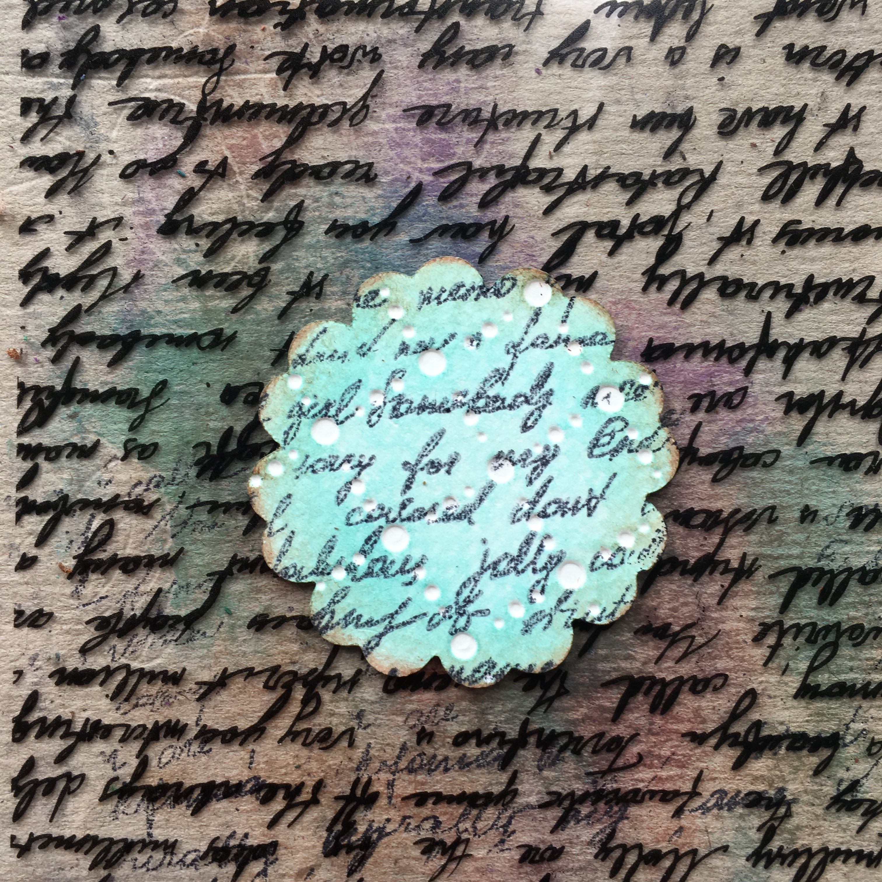 letter stamp and turquoise embossed floral element