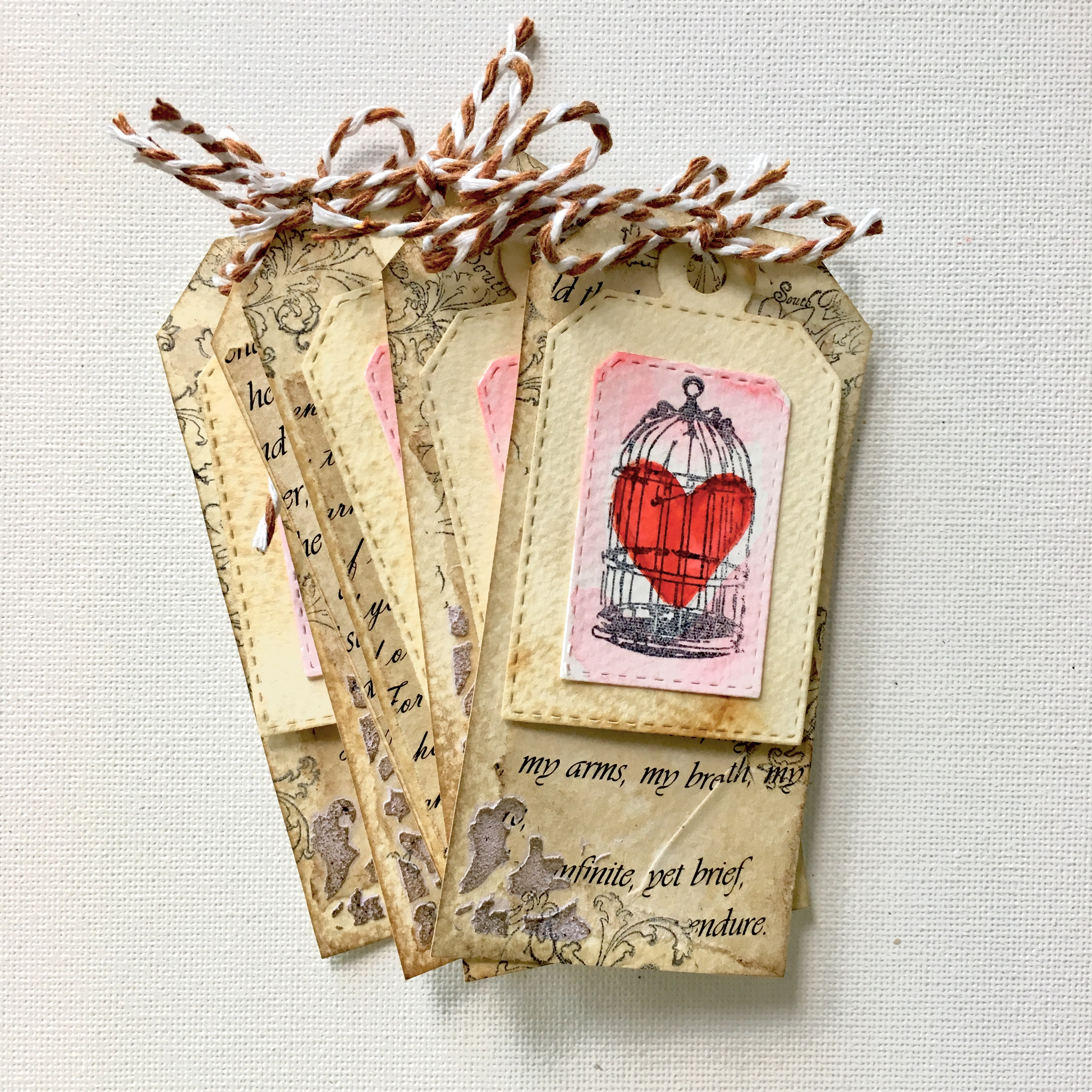 vintage style gift tags in brown with red hearts in a cage watercolour drawing
