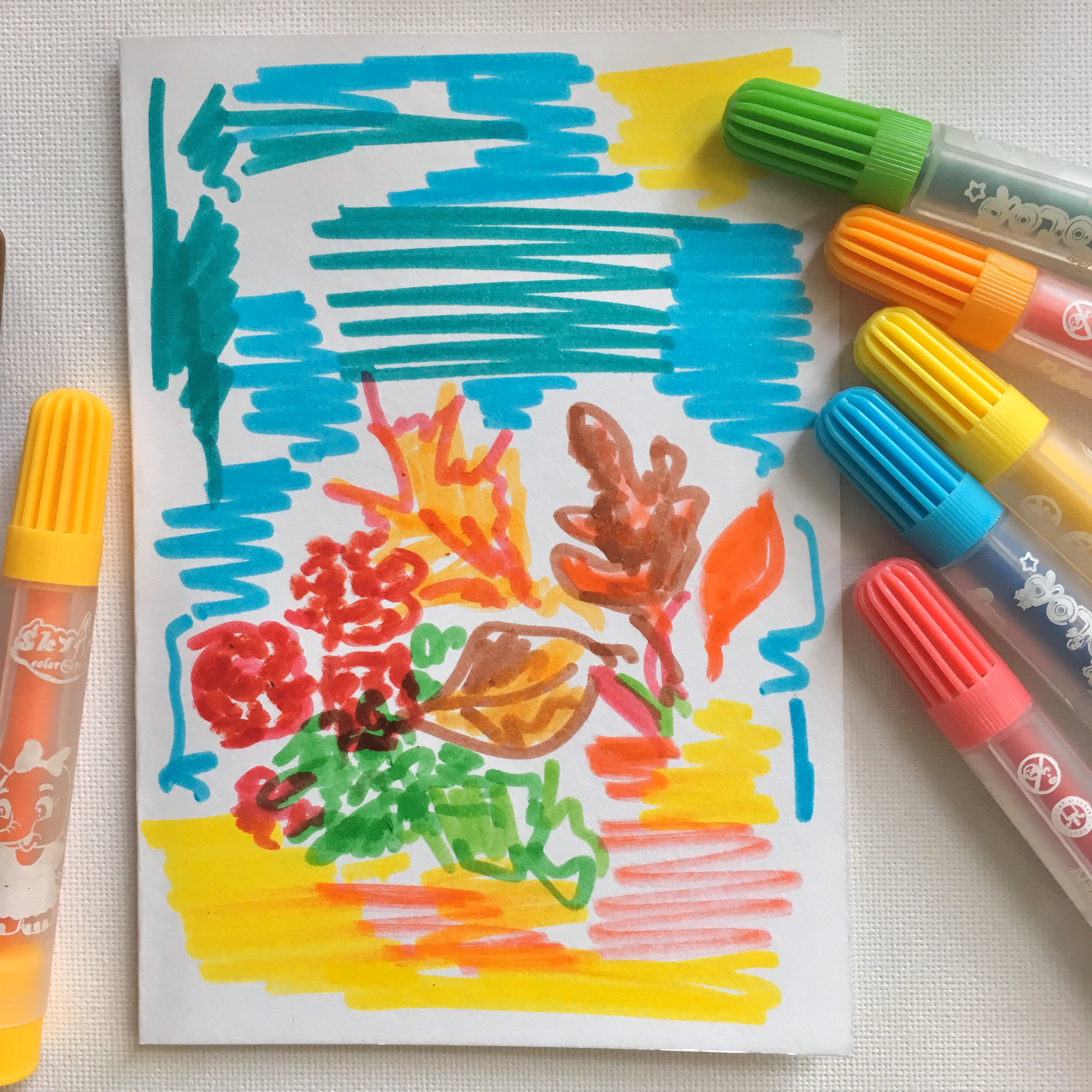 watercolour markers and sketches of leaves, Pelargonium blosoms in red, blue sky and sea and some Autumn leaves in orange, brown and yellow