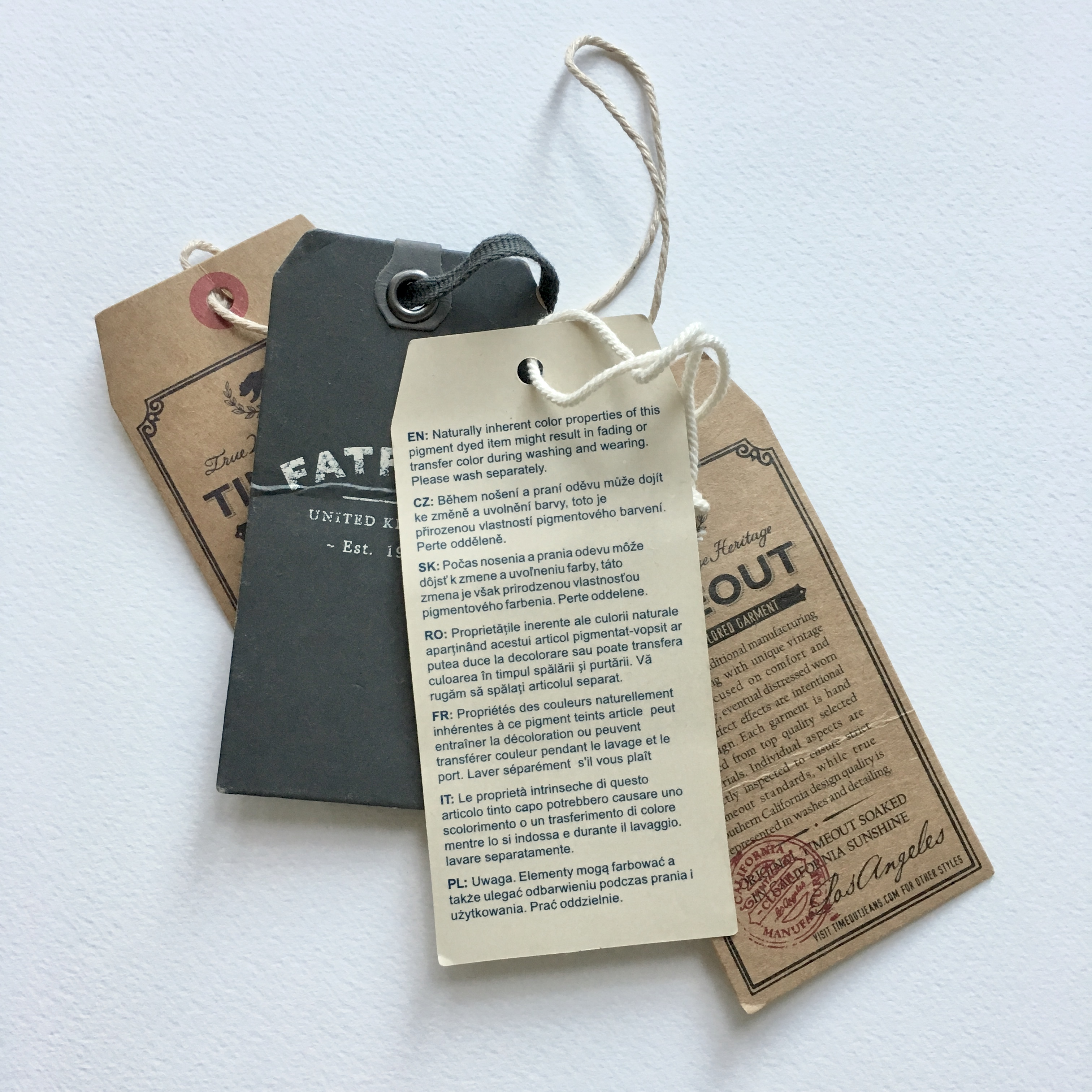 clothes paper tags in brown, beige and dark grey