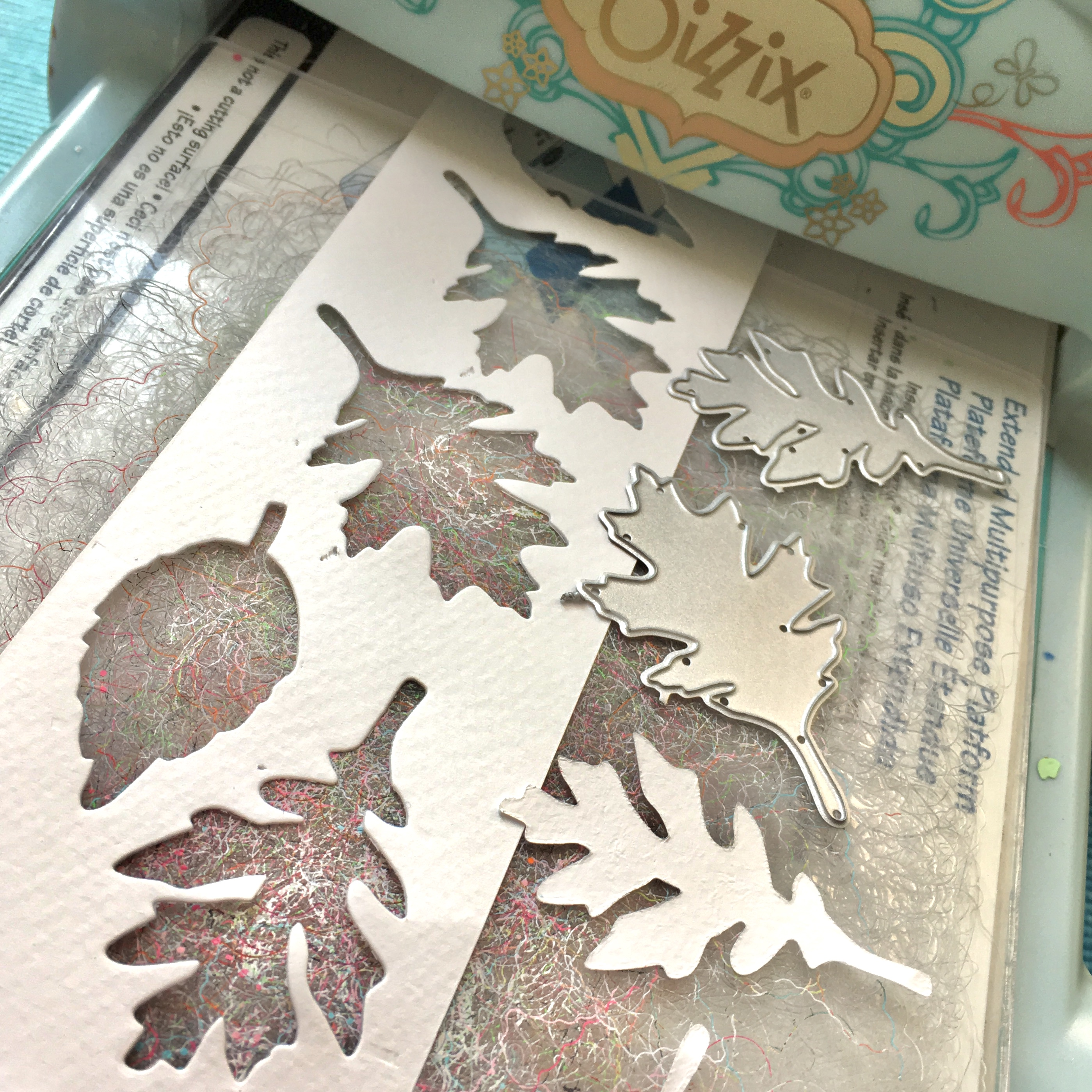 Sizzix Big shot machine and cut white leaves