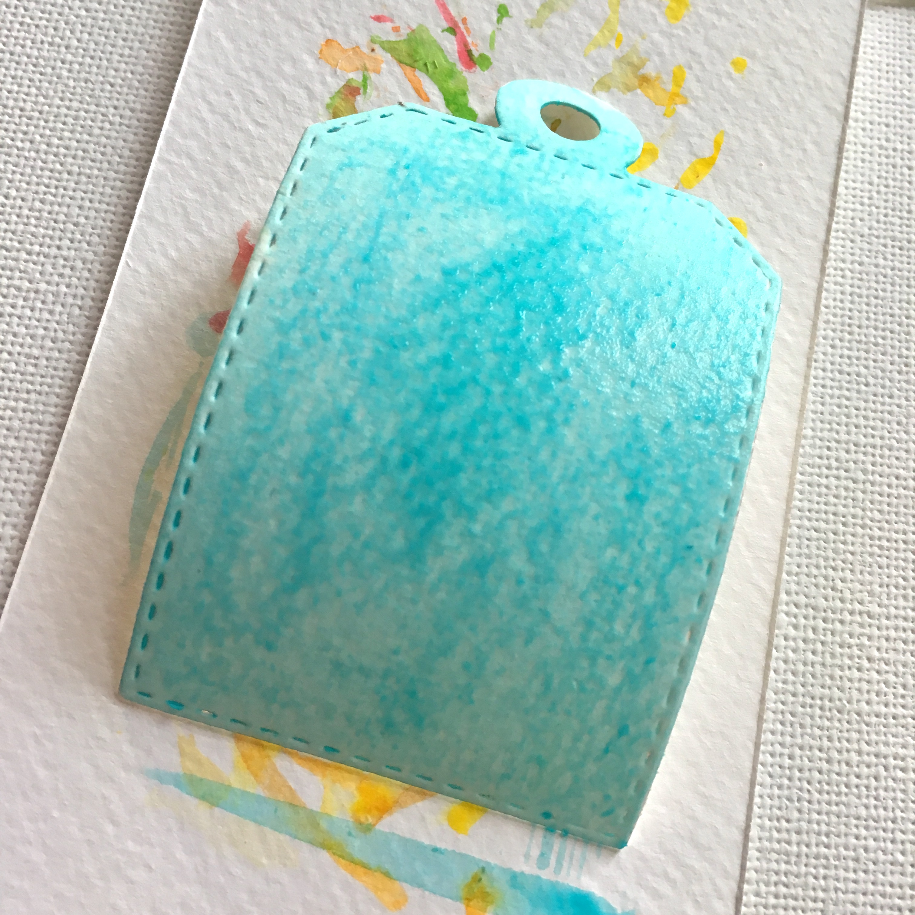 paper tag, coloured in light blue