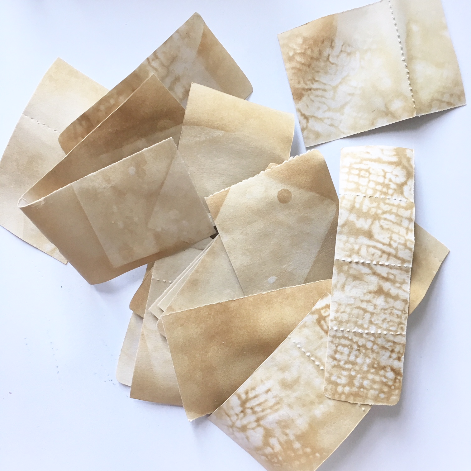 dried coffee tinted pieces of paper