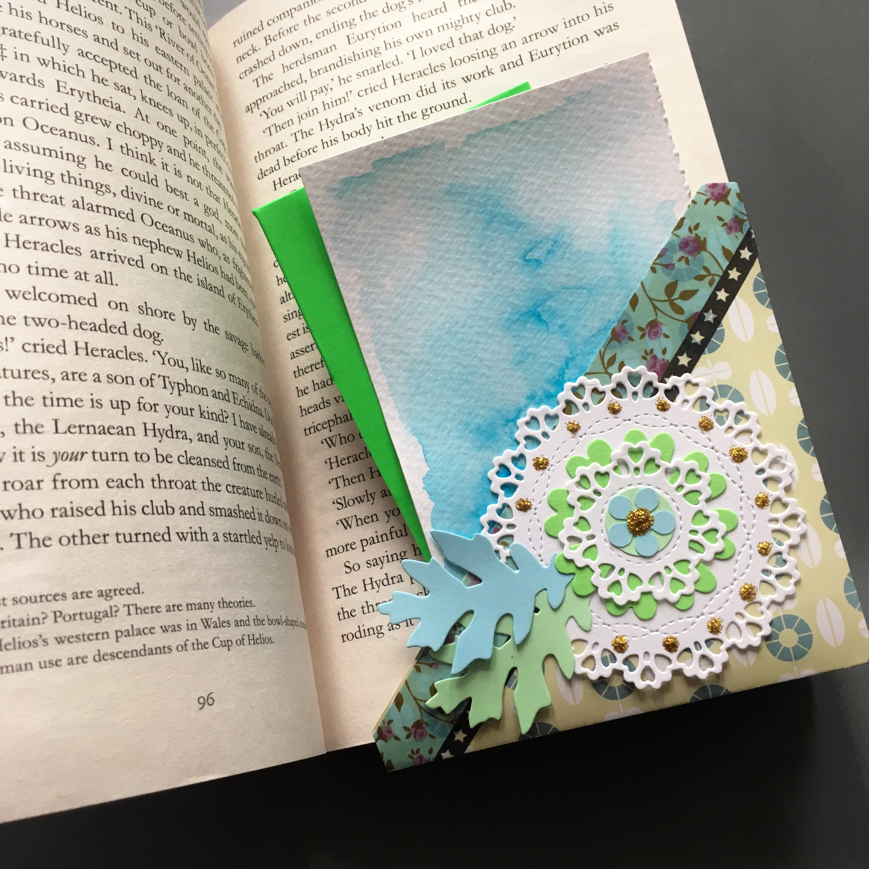 book with a pocket bookmark and notes and other pieces of paper in the pocket