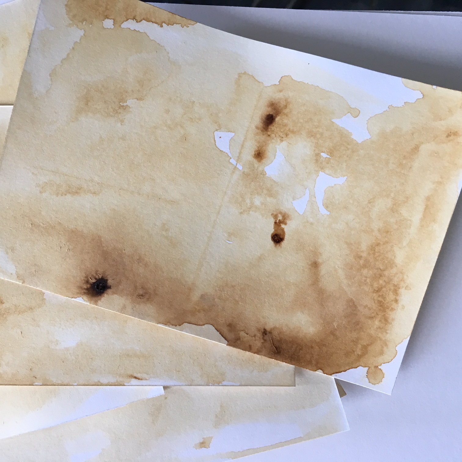 big brown coffee spots on white paper
