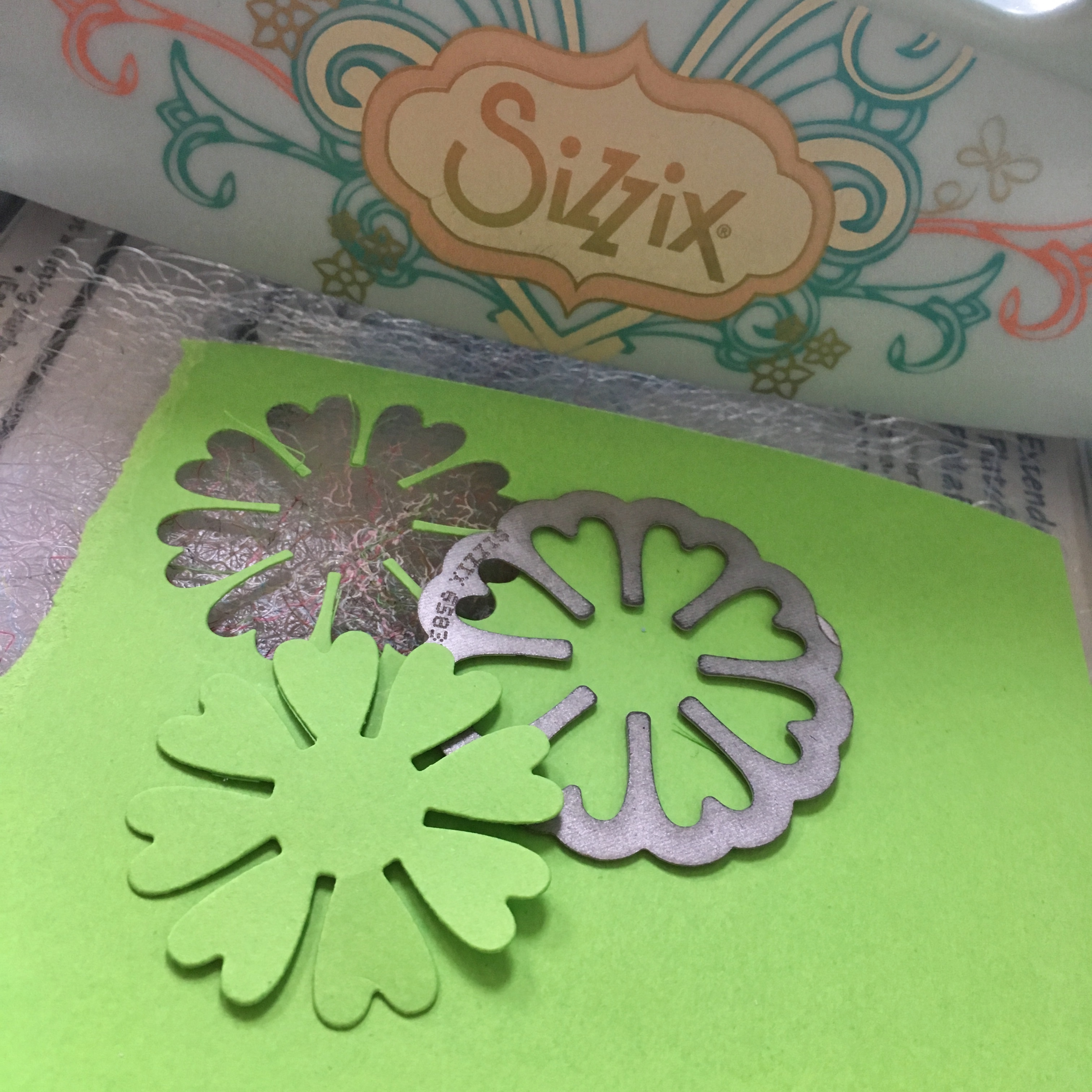 Sizzix cutting machine with floral dies and green paper