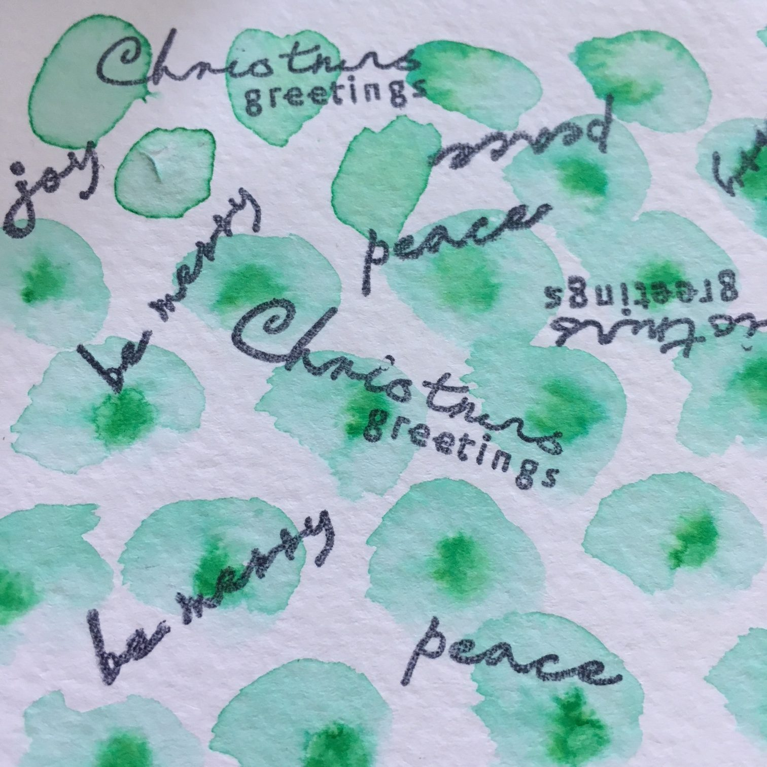 watercolour painted design with Christmas stamps