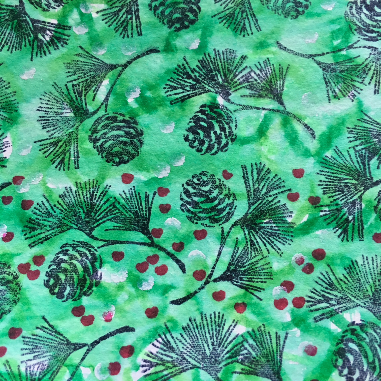 green watercolour background with pine branches stamping and red marker dots