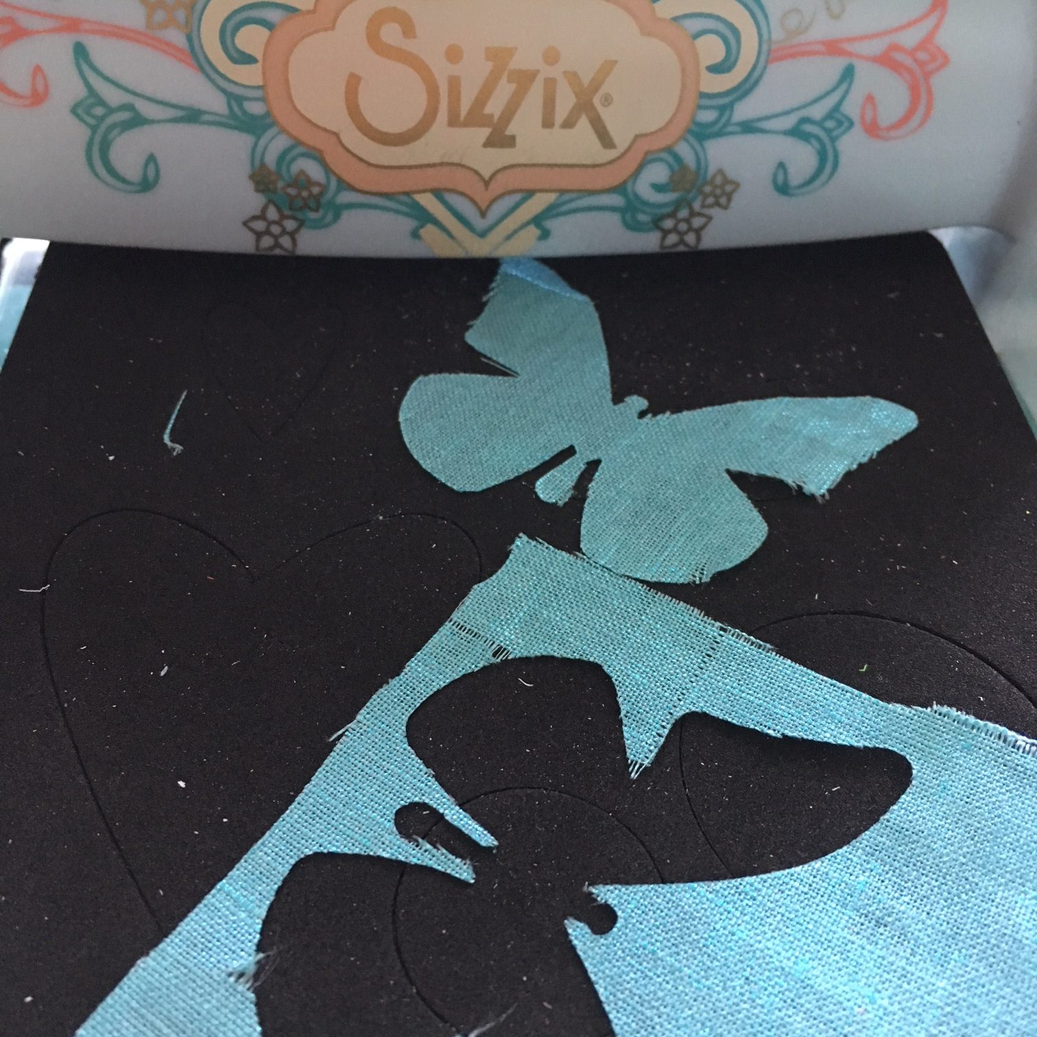 Sizzix cutting machine and silk butterfly in blue