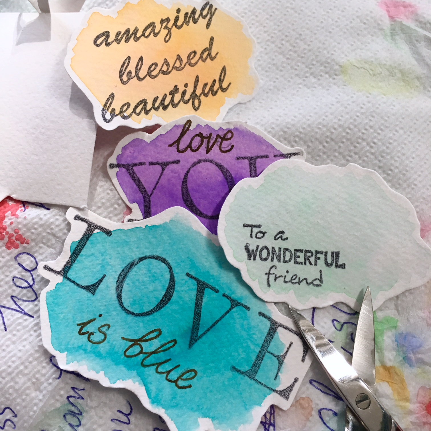 "watercolour spots with stamps ""love"", ""you are wonderful"", ""love you"" etc..."