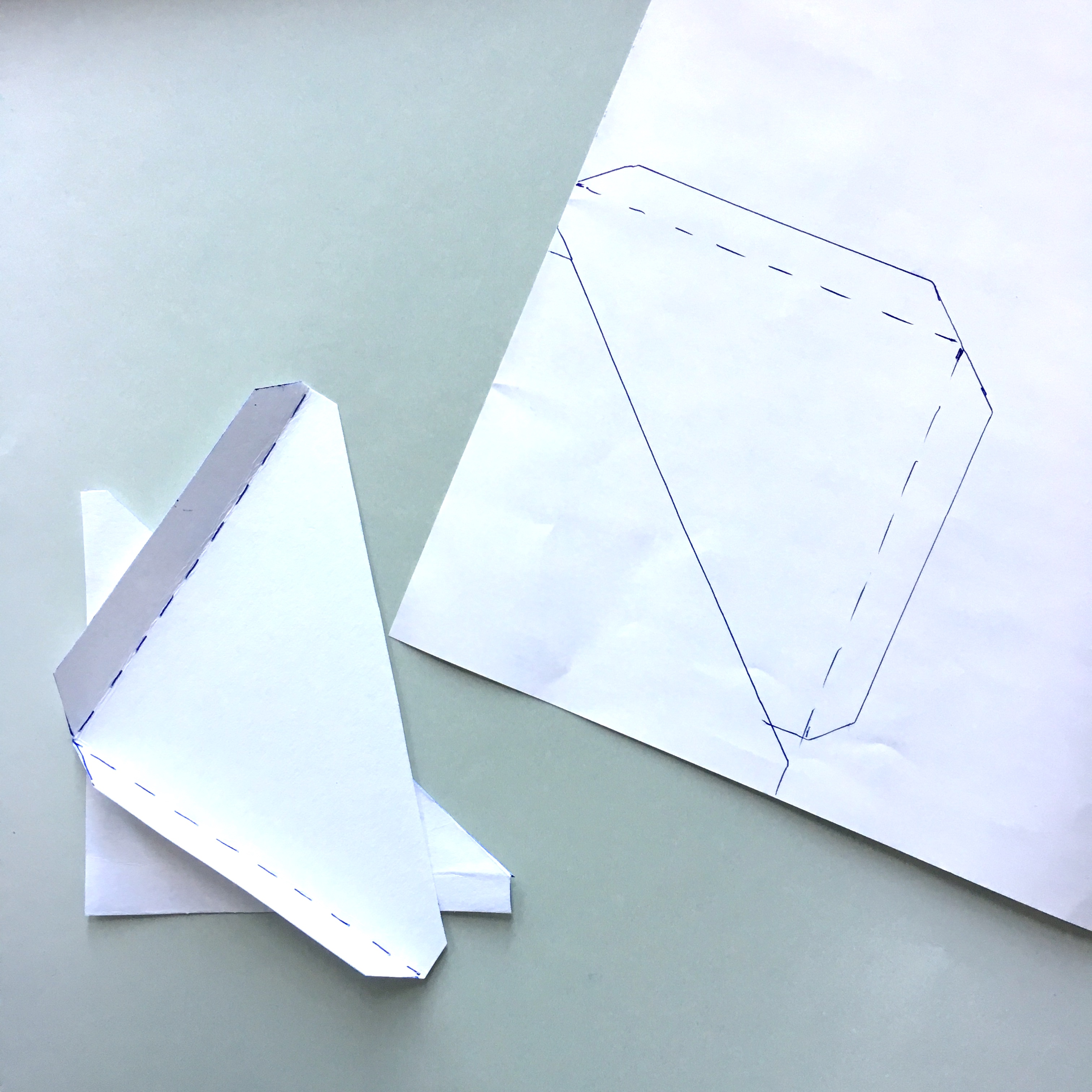 triangle pocket bookmark from paper with a floral design