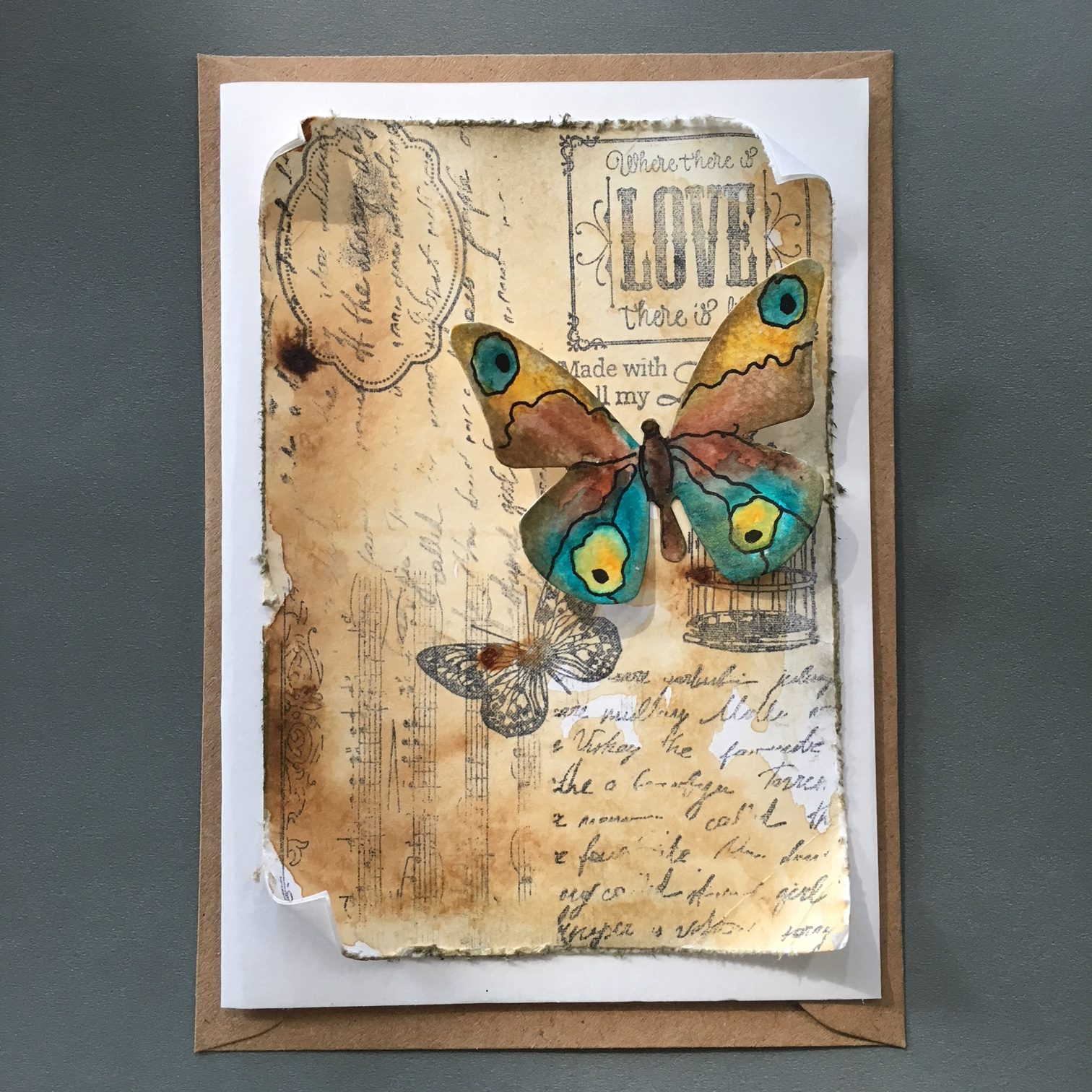 vintage style greeting card with paper butterfly and stamps