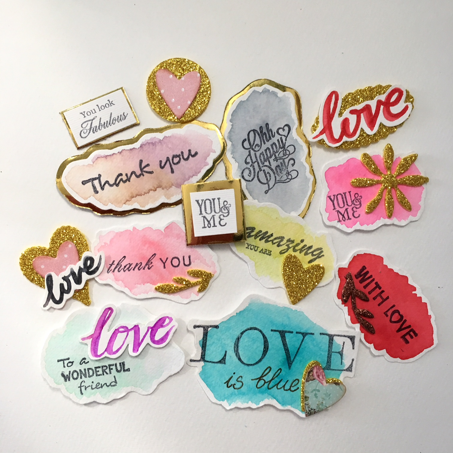 scrapbook embellishments in blue, pink, red and golden
