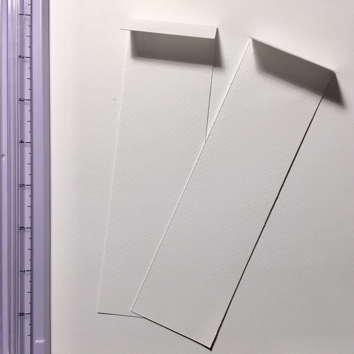 2 long rectangles from white watercolour paper