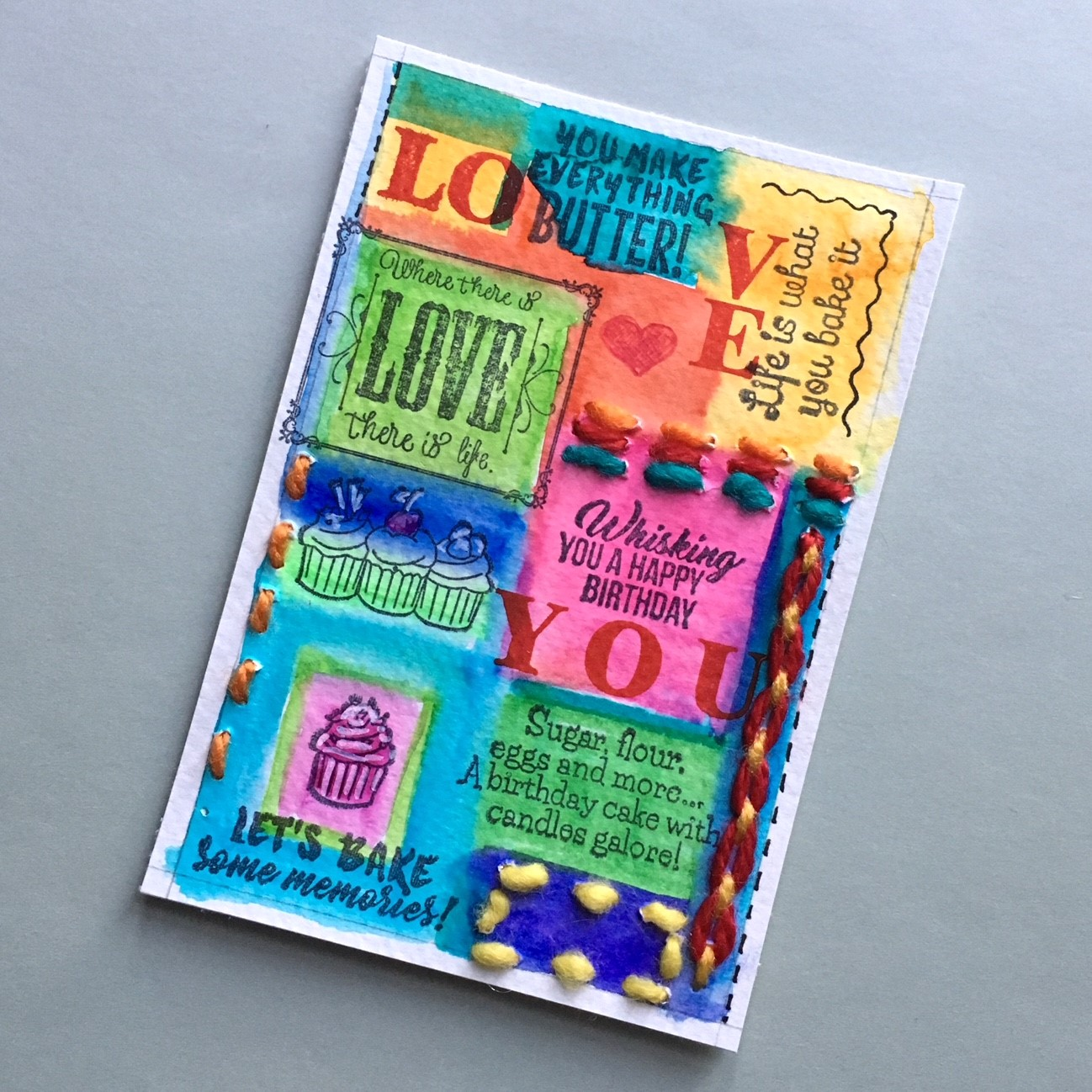 hippie style greeting card - the stamped paper with embroidered strokes in red, blue and yellow