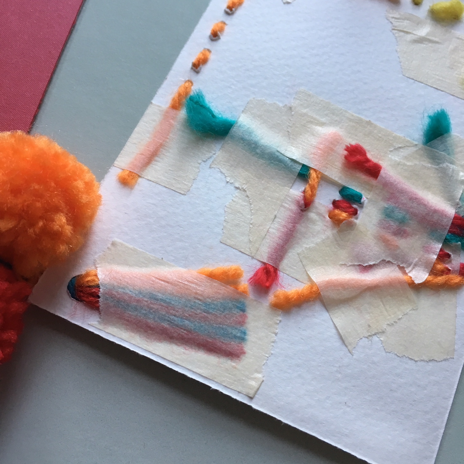 the back of the hippie style greeting card - every wool end is carefully glued and fixed with flue and paper tape
