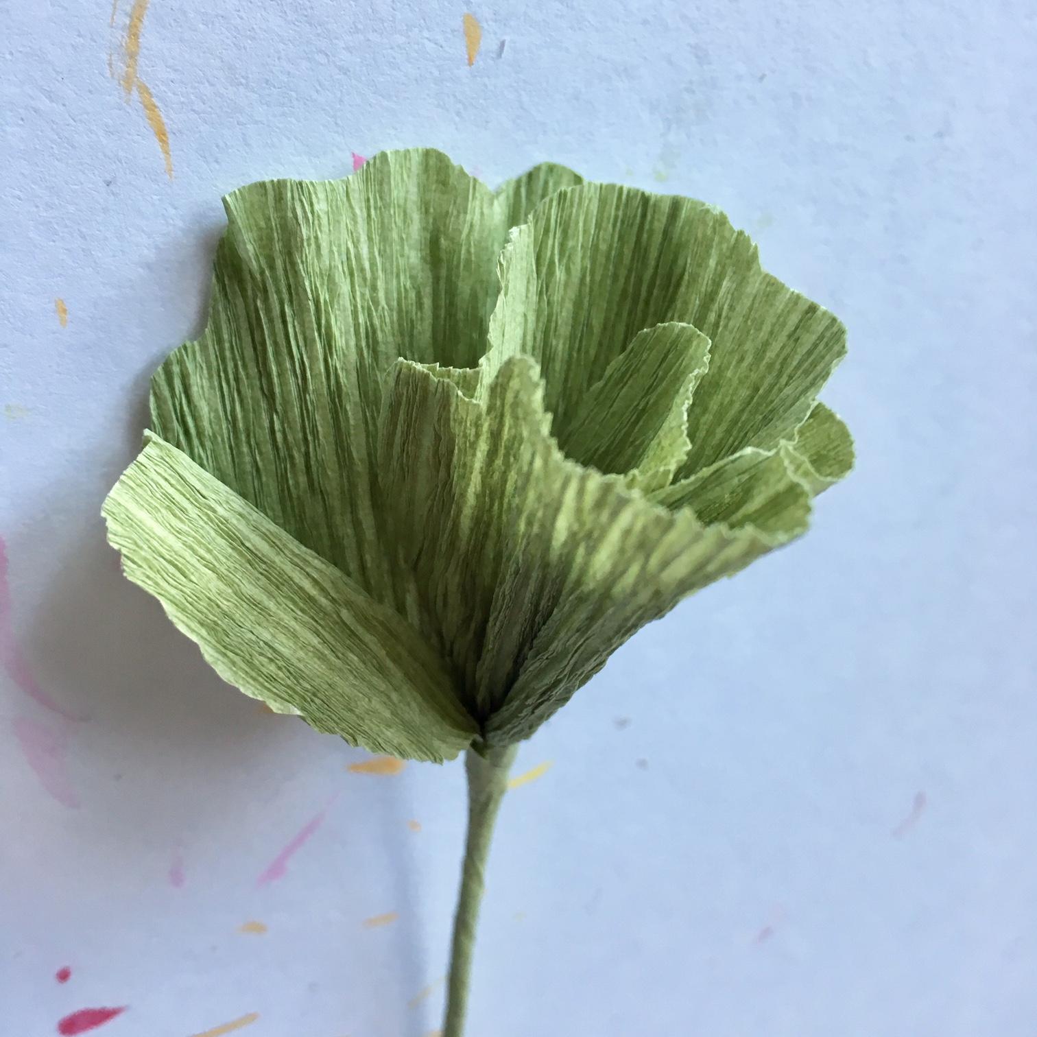 twisting the leaf around green paper wire