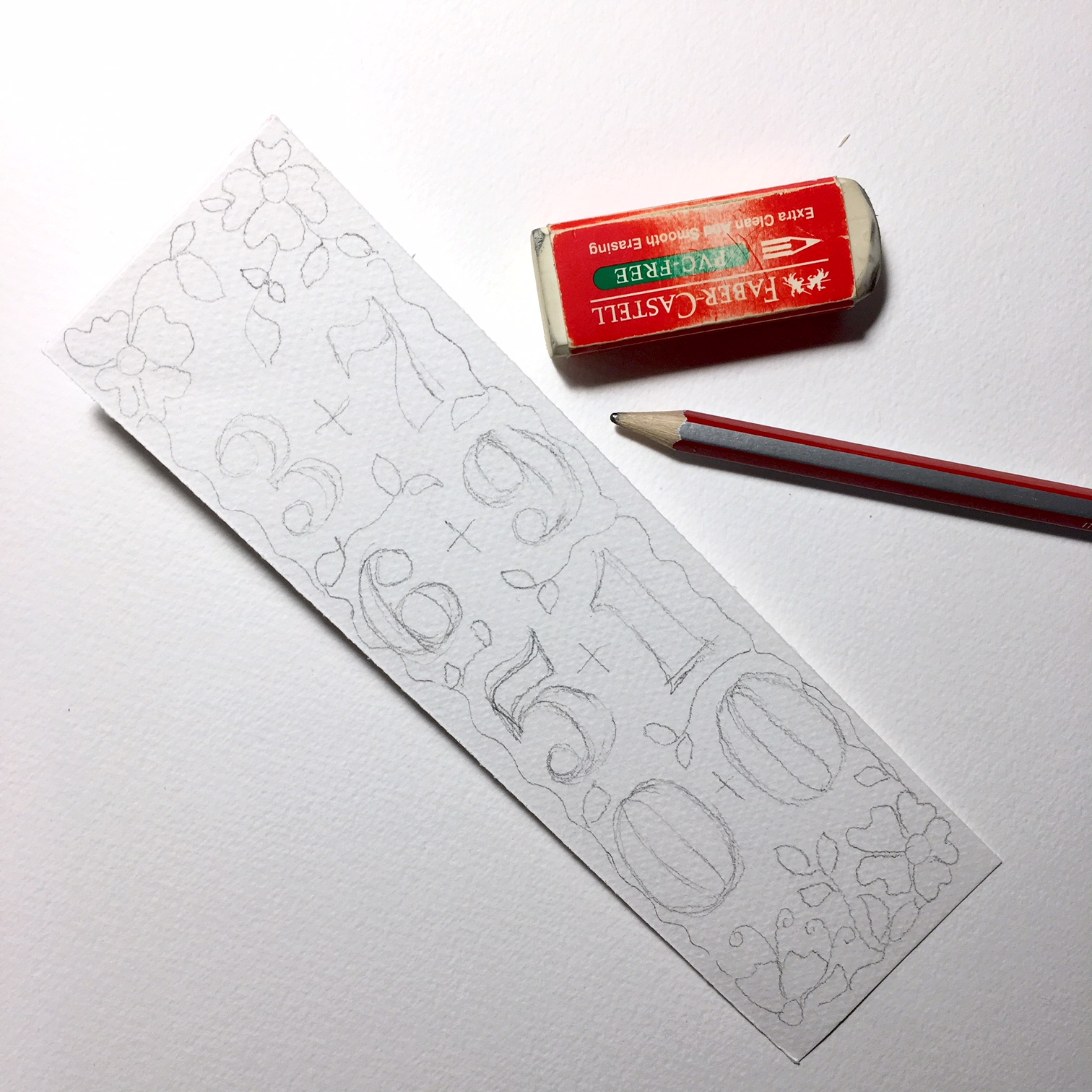 handmade bookmarks - long rectangle from white watercolour paper with numbers drawn, pencil and eraser