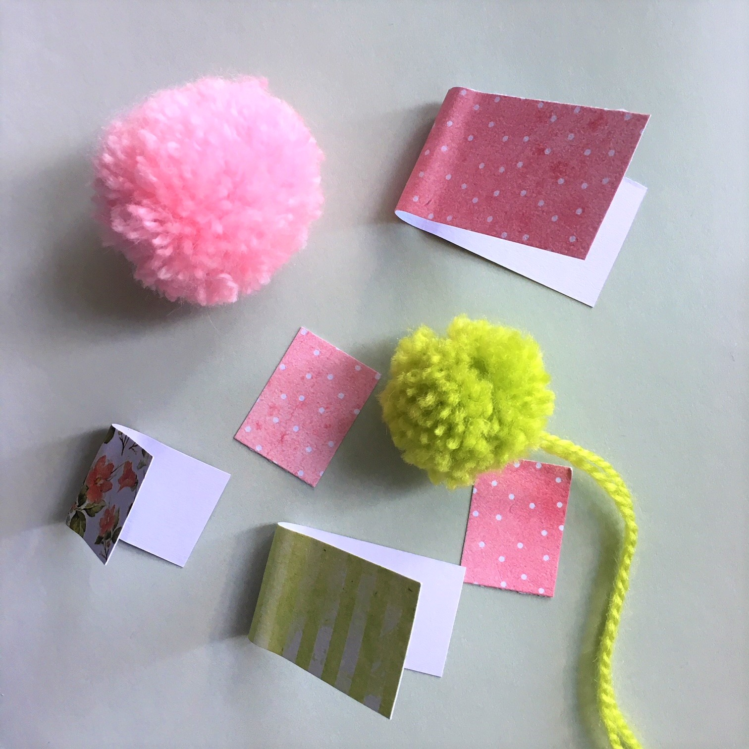 pompoms and paper rectangles