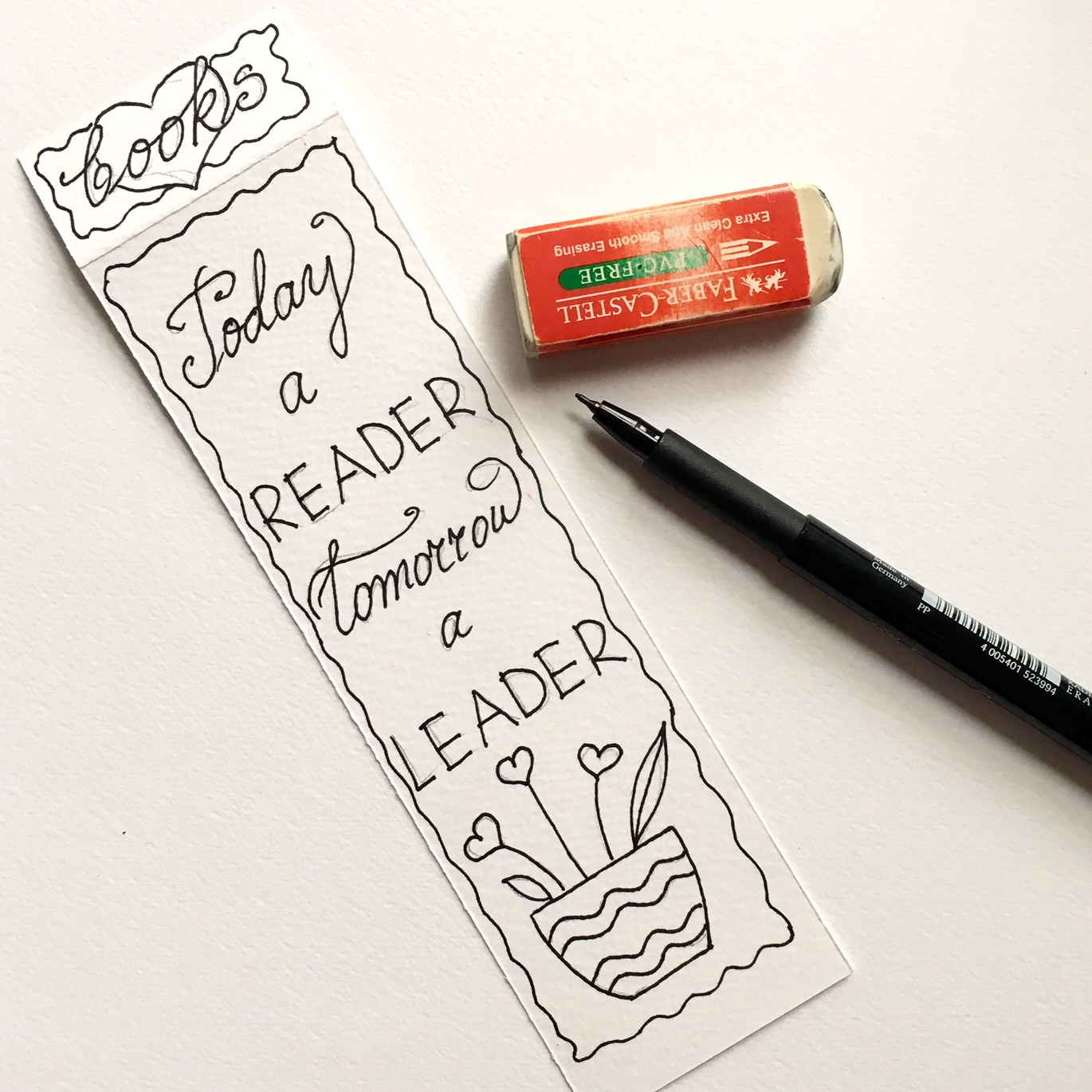 drawing and handwriting with black alcohol based marker to make a colouring image on a handmade bookmark