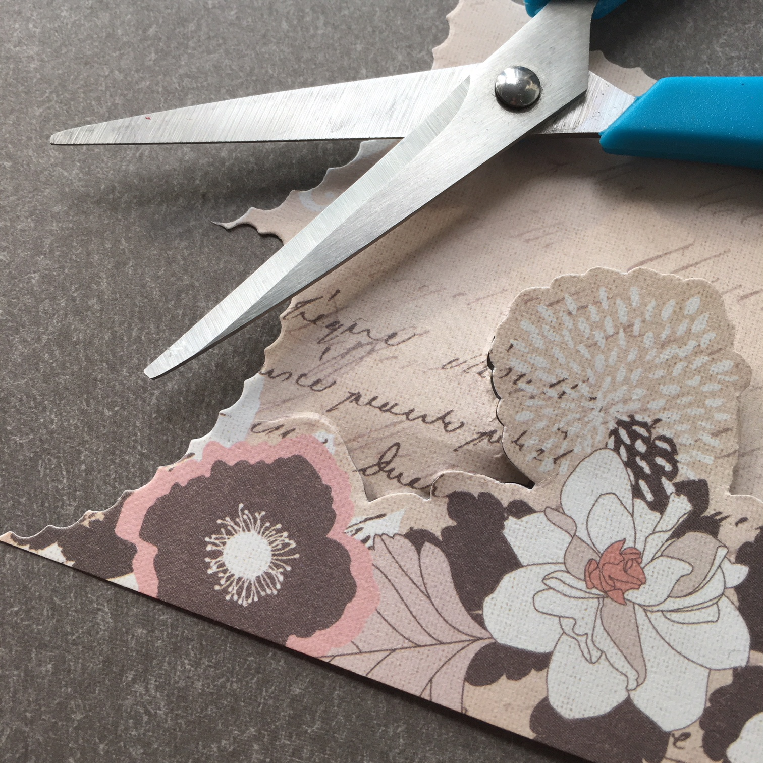 scissors and craft paper with flowers
