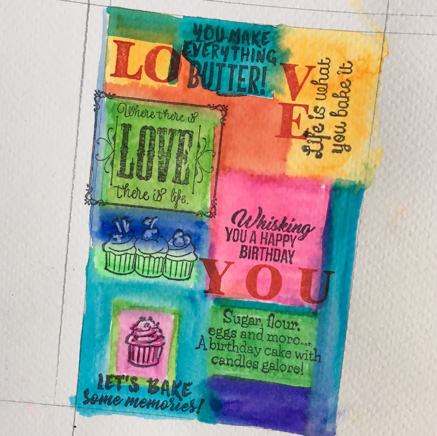 the watercolour rectangles are stamped with different images and black ink