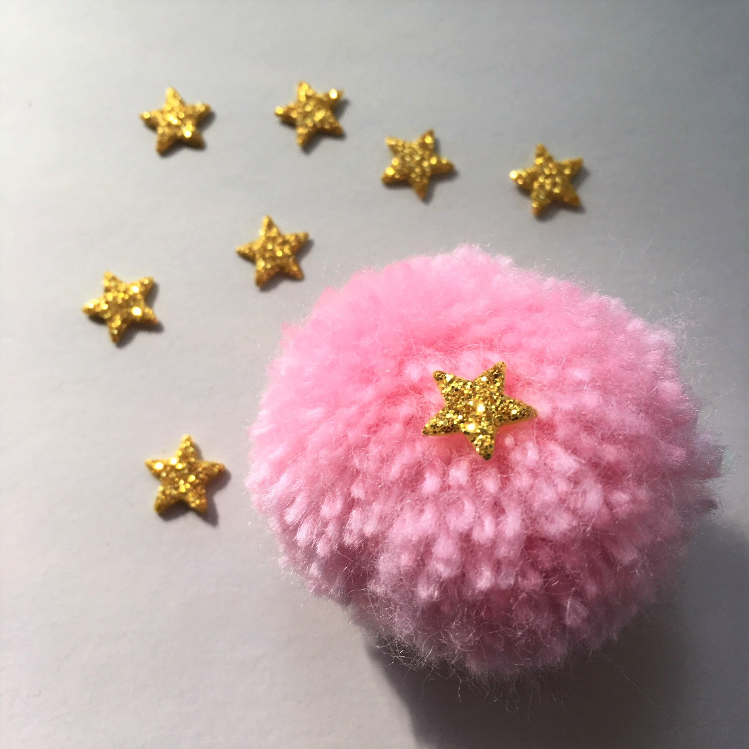 glitter foam stars glued on the pompom with hot silicone - pencils for school princesses