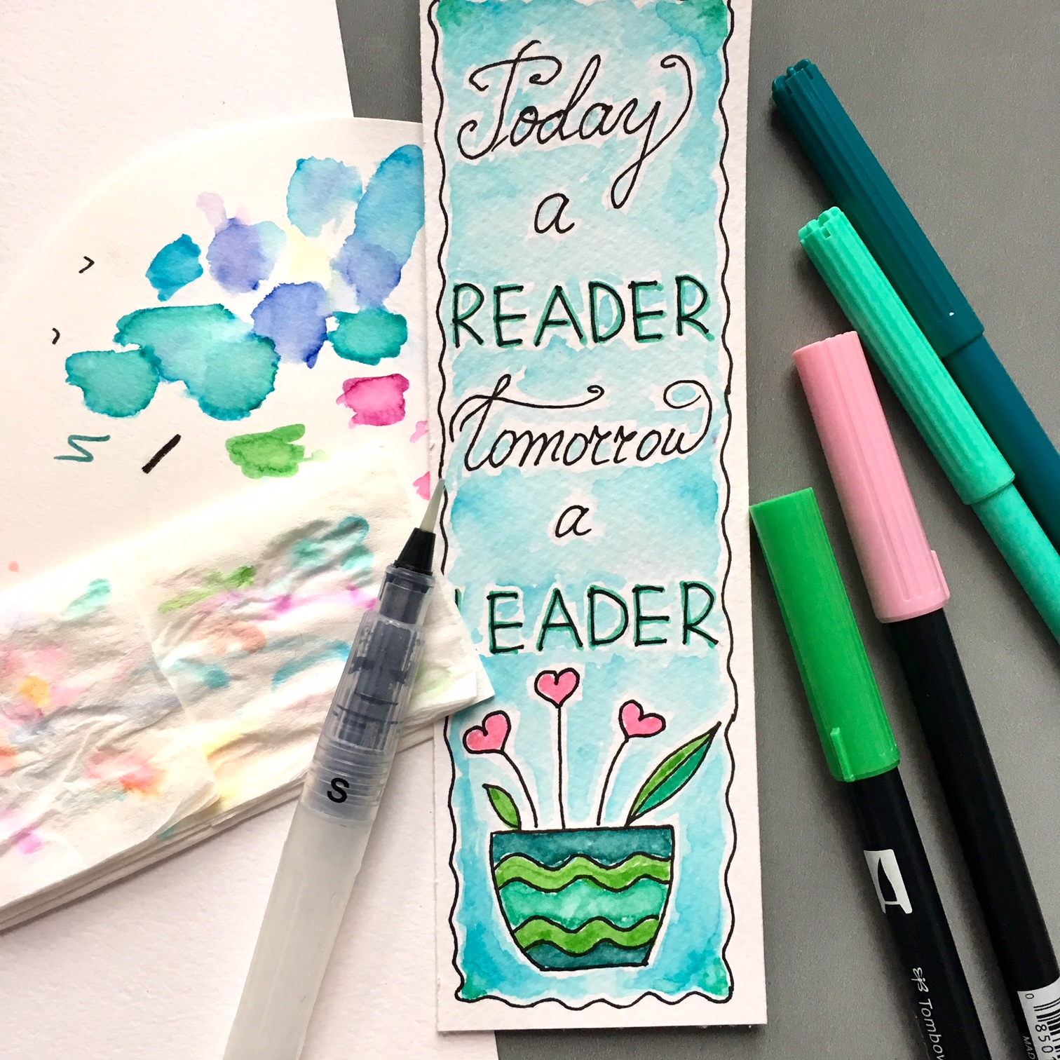 """coloured bookmark """"Today a reader, tomorrow a leader"""", container brush and markers"""