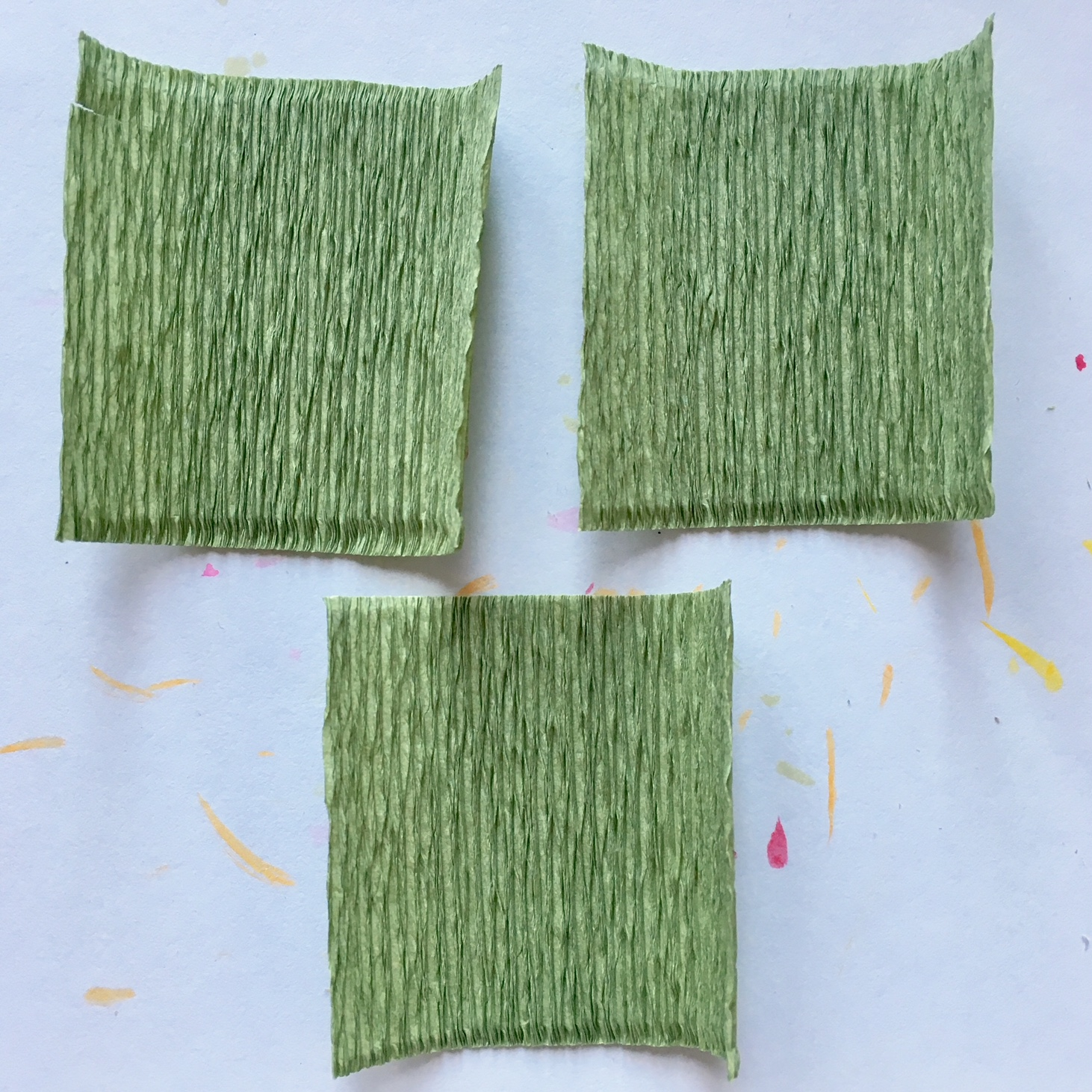3 green crepe paper rectangles for making leaves