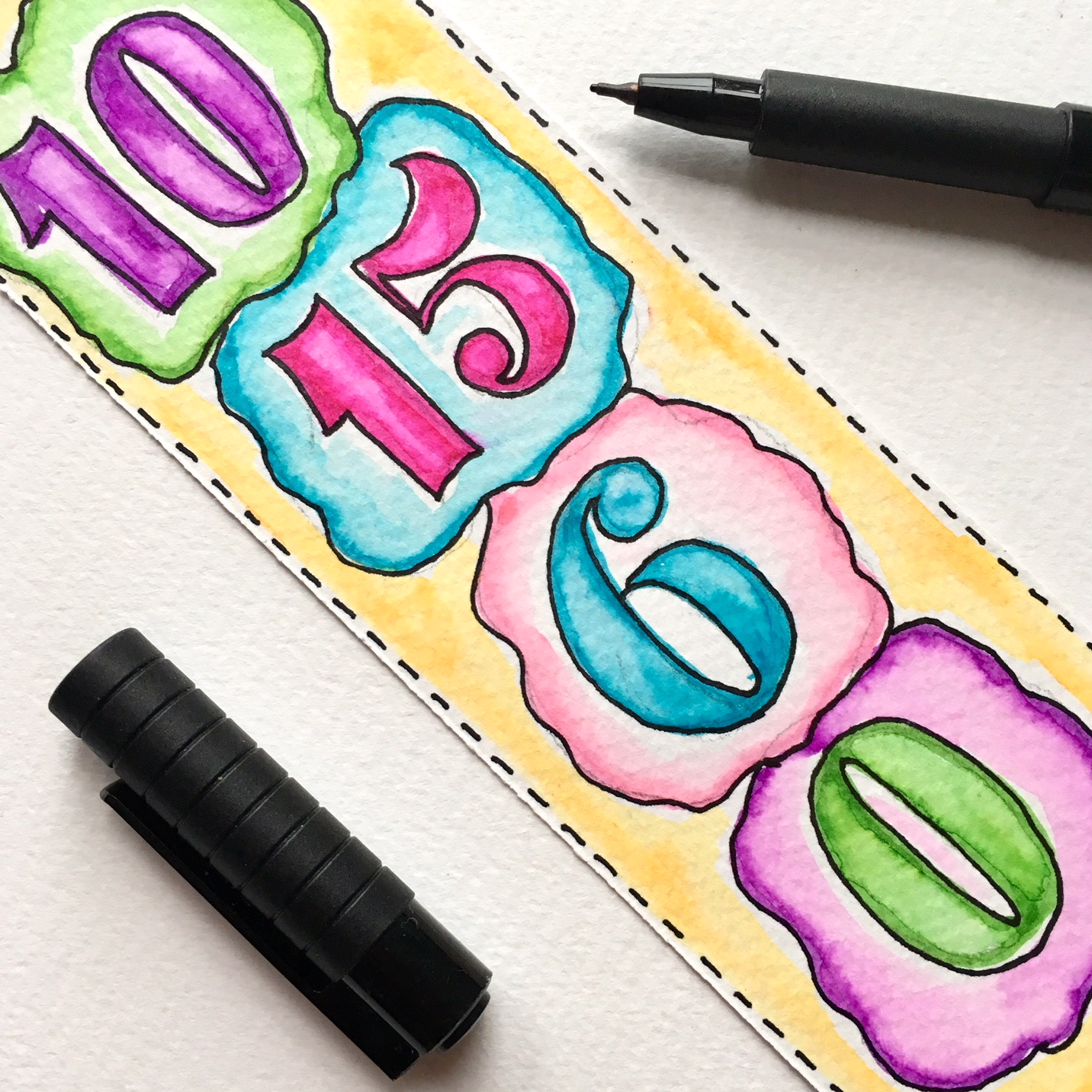 answers of the sums on the reverse side of the handmade bookmark