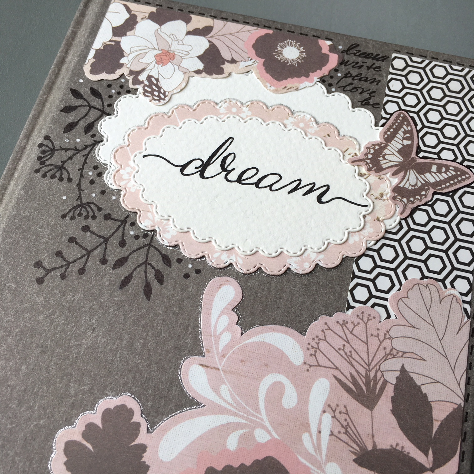 notebook label from white and pink paper and black flowers drawn around