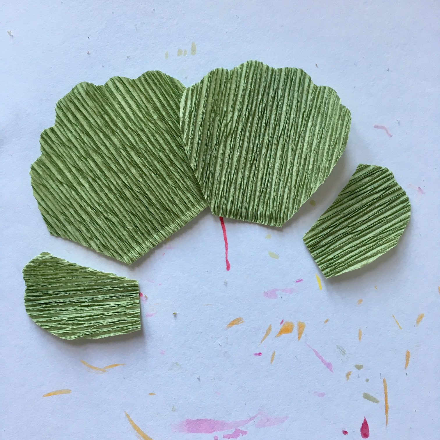 making crepe paper pelargonium leaves, by gluing together 3 paper shapes