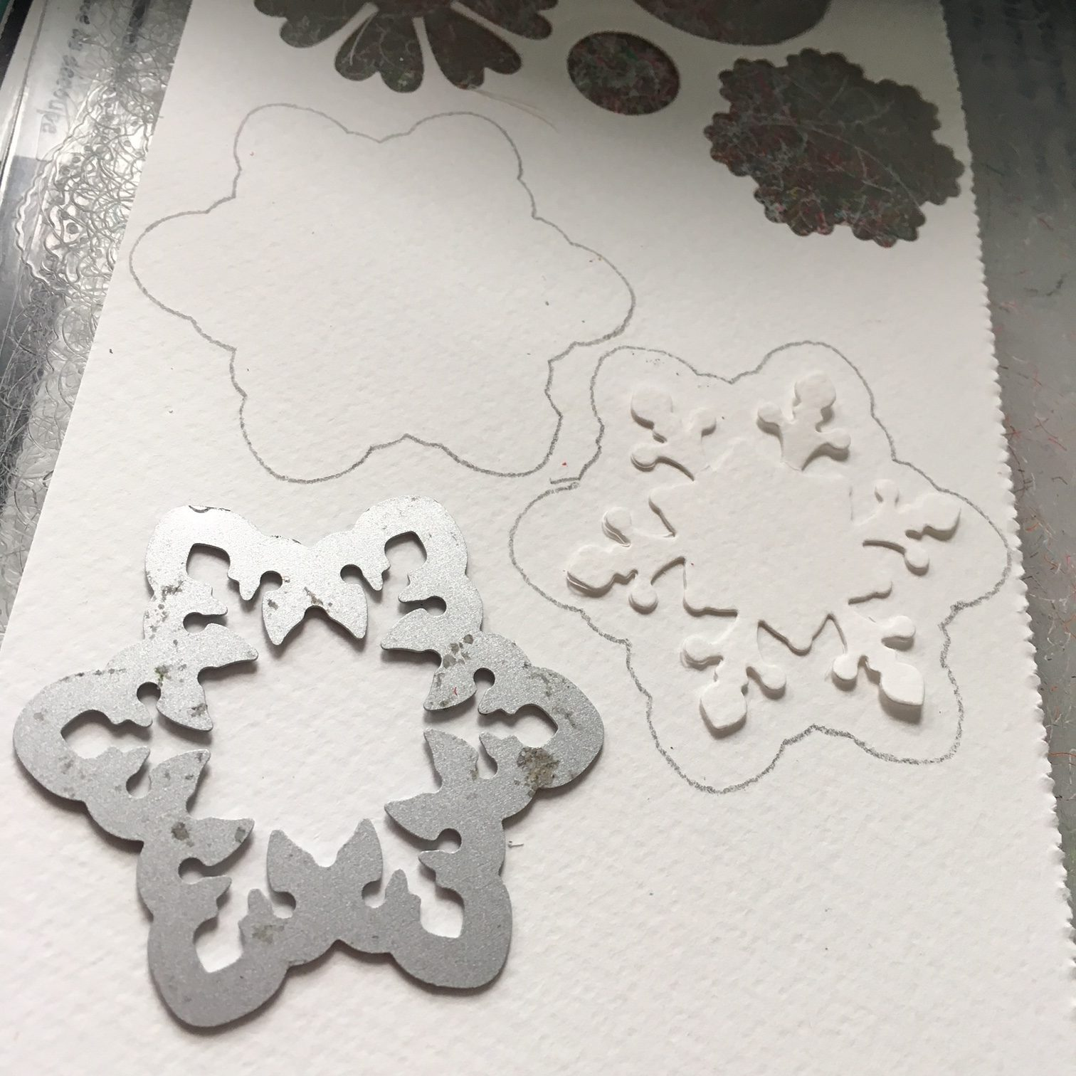 snowflake paper die on white watercolour paper