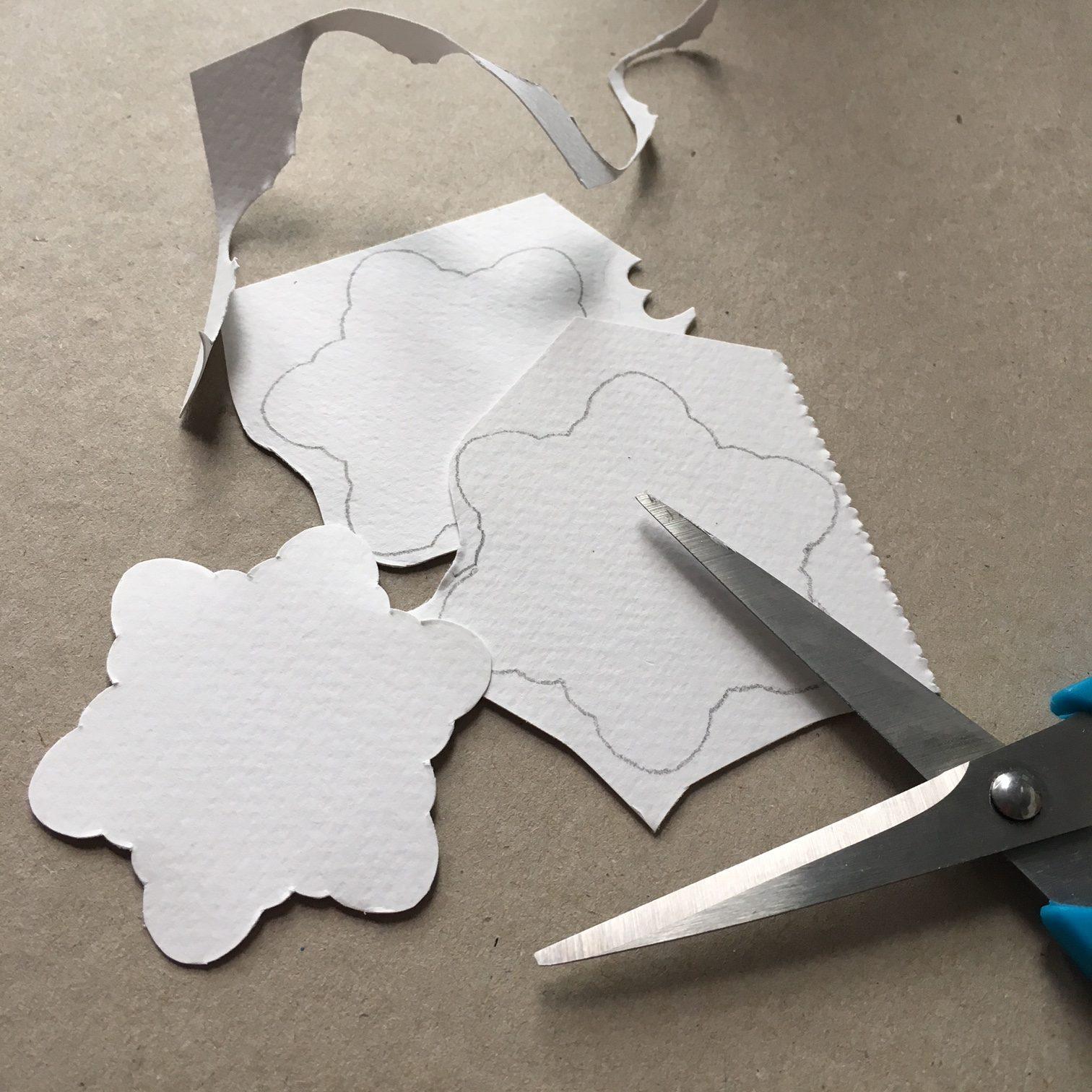 scissors and paper snowflake shape cut