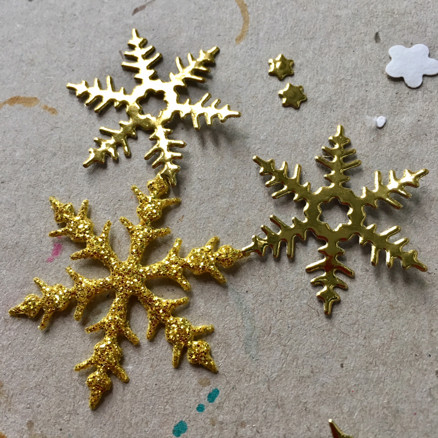 glitter and golden paper snowflakes