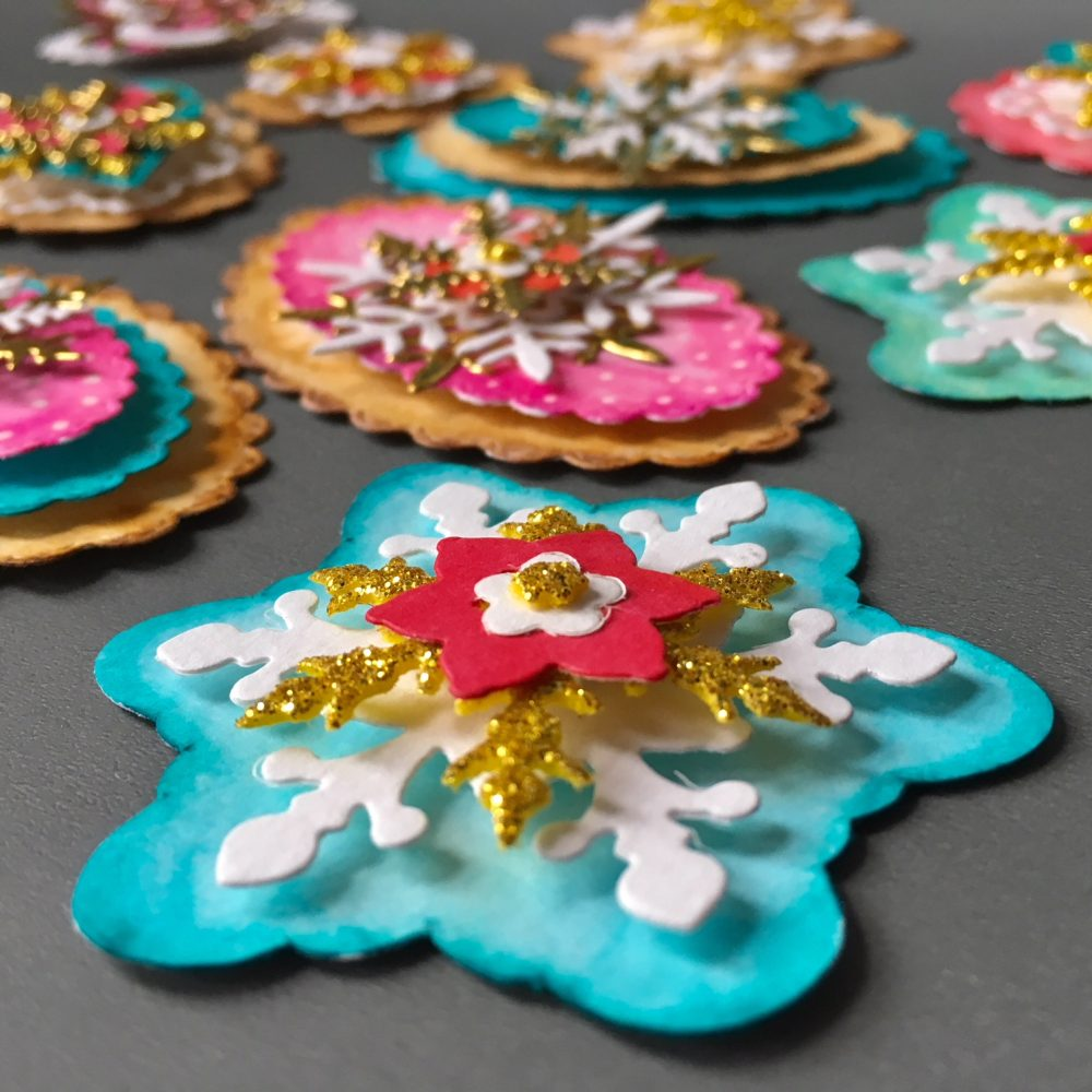 Christmas embellishments in turquoise, red, pink and gold with cookie and snowflake shapes